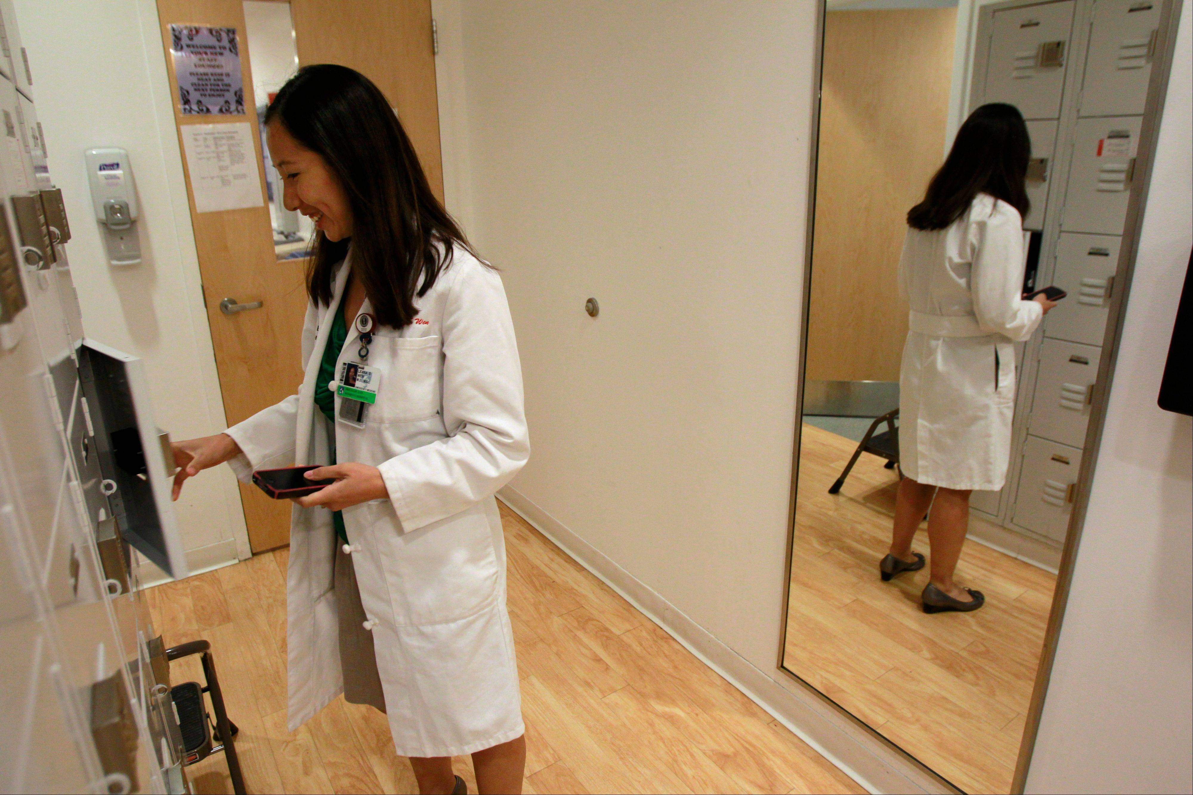 Leana Wen deposits some personal belongings in a locker in the emergency department at Brigham and Women's Hospital in Boston.