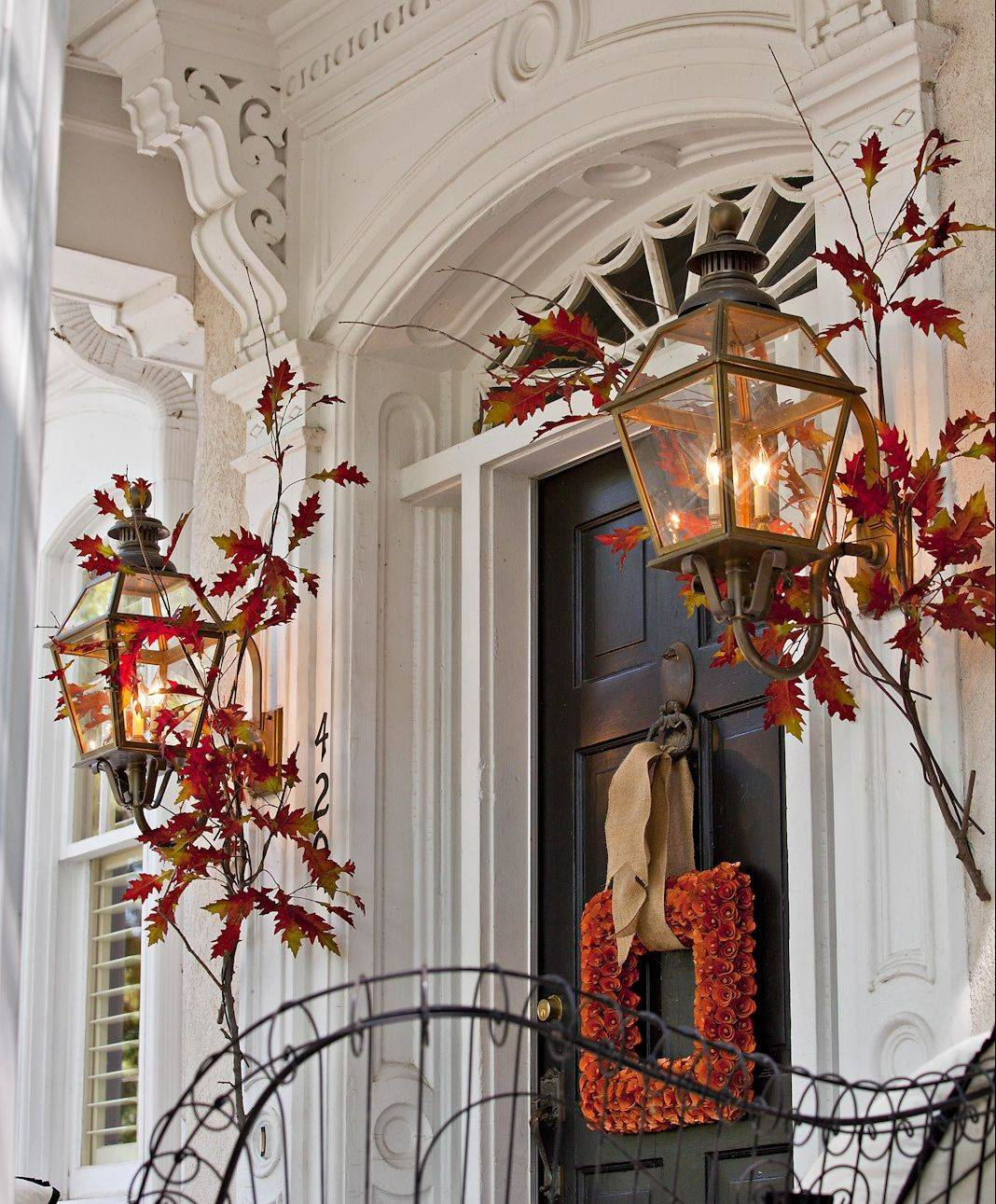 If you have time to decorate only one outside spot this fall, make it your front door.