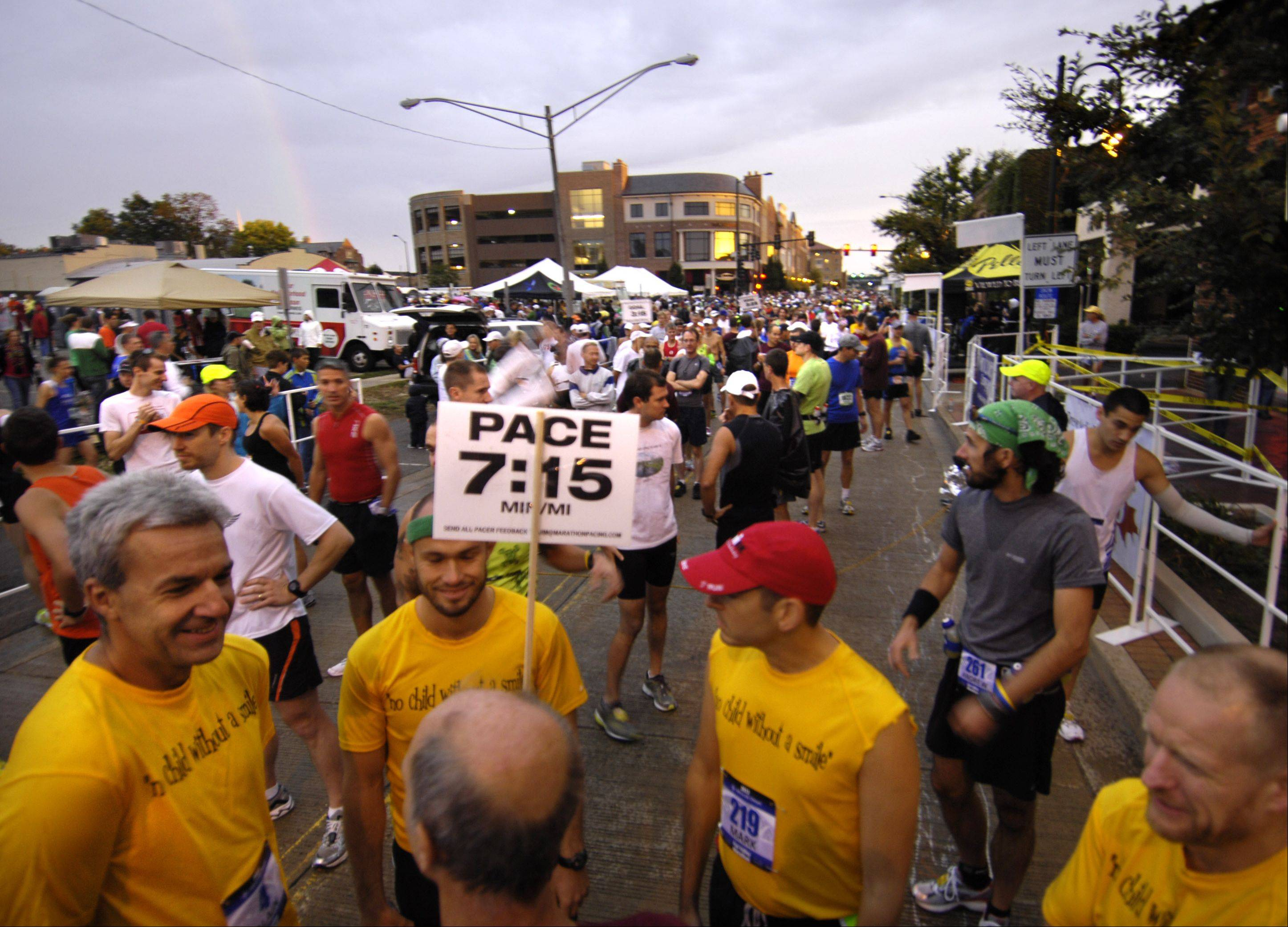 Runners start to gather near the finish line before last year's Fox Valley Marathon Races in St. Charles. More than 2,000 competitors ran a half marathon, a 20 mile race, and a full 26.2 mile marathon, as well as a kid's race. Eventual marathon winner Tim Cunningham of Virginia is at lower left, partly obscured by the sign. He ran the entire race in bare feet.