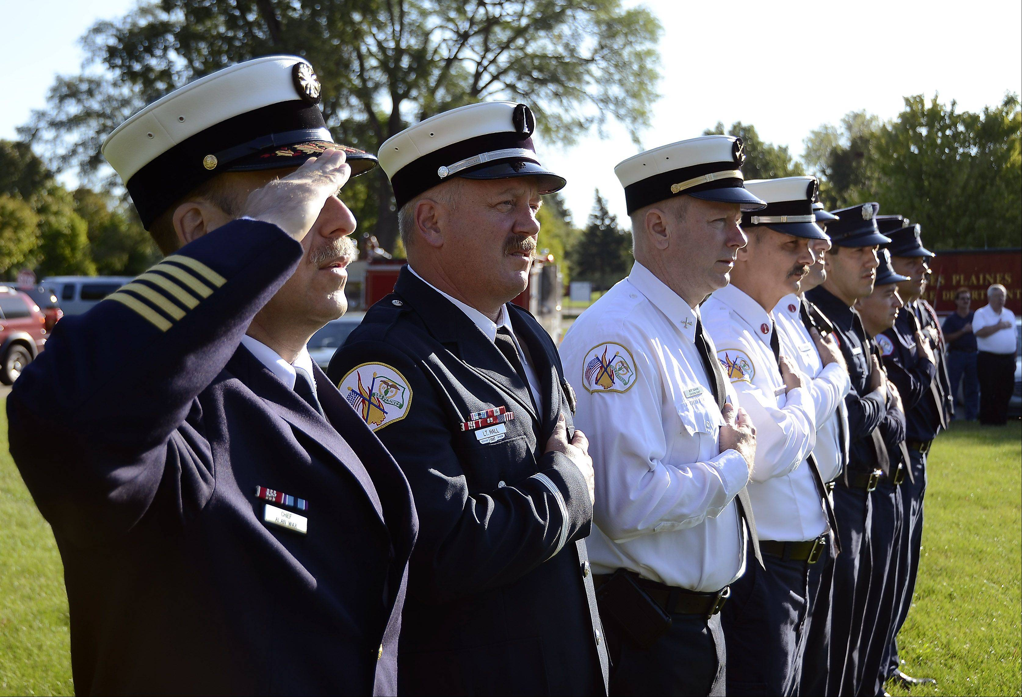 Firefighters and police say The Pledge of Allegiance during a 9/11 Patriot Day ceremony at Maryville Academy in Des Plaines
