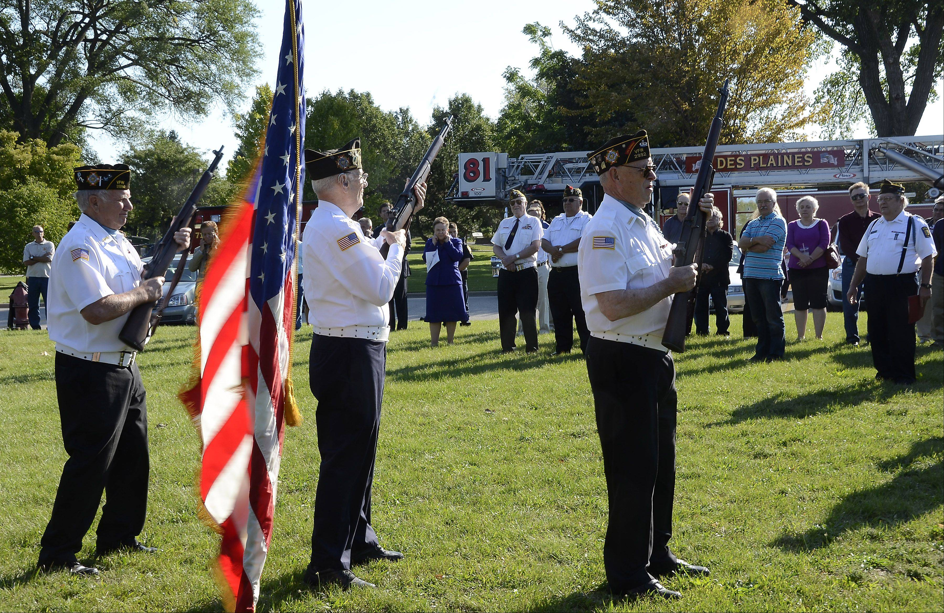 Members of a combined honor guard made up of members from American Legion Post 36 and Veterans of Foreign Wars Post 2992 fire a salute during a 9/11 Patriot Day ceremony at Maryville Academy in Des Plaines.