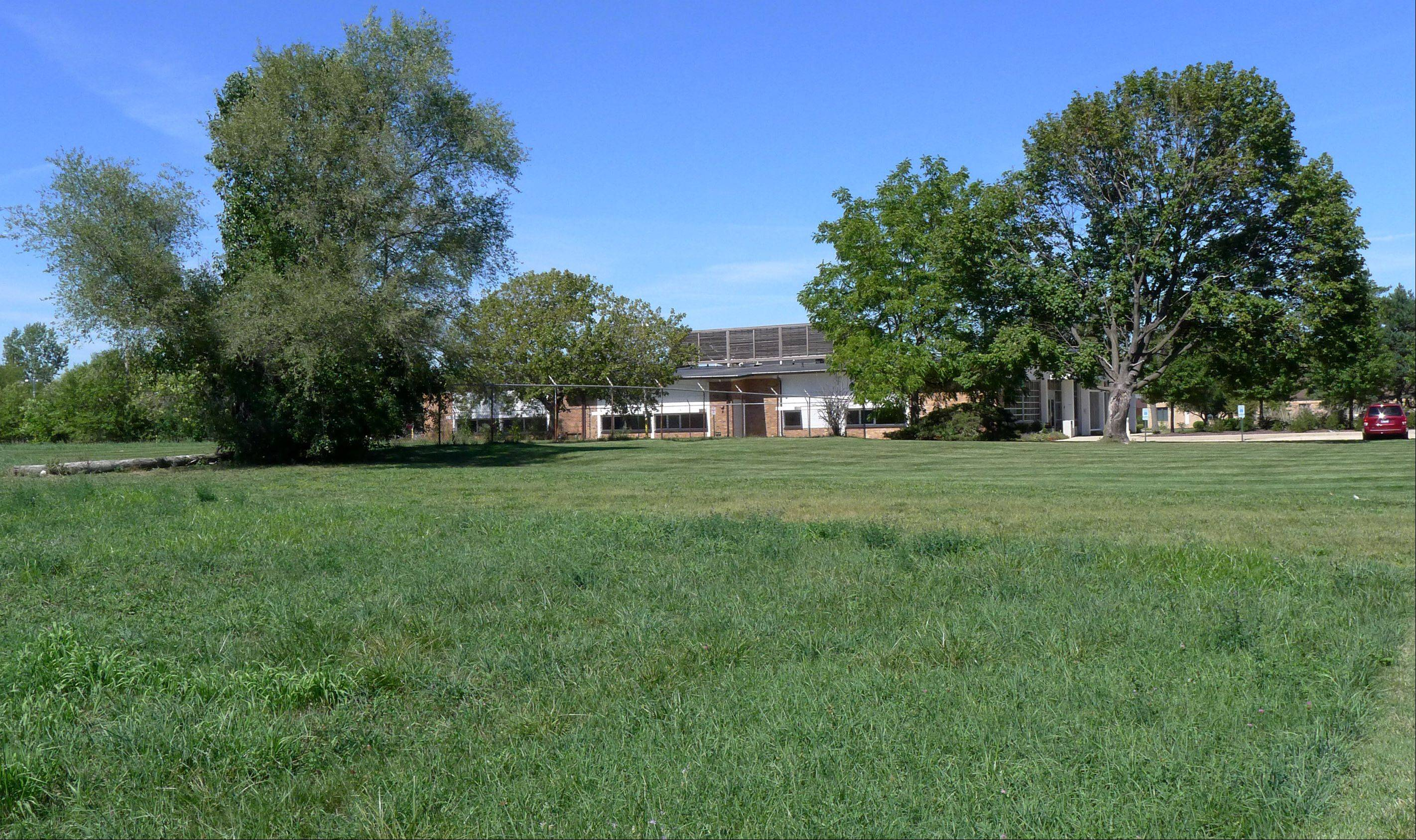 The Carol Stream Library Board is deciding whether to sell vacant property on the west side of Kuhn Rd. just south of the College Of DuPage building.