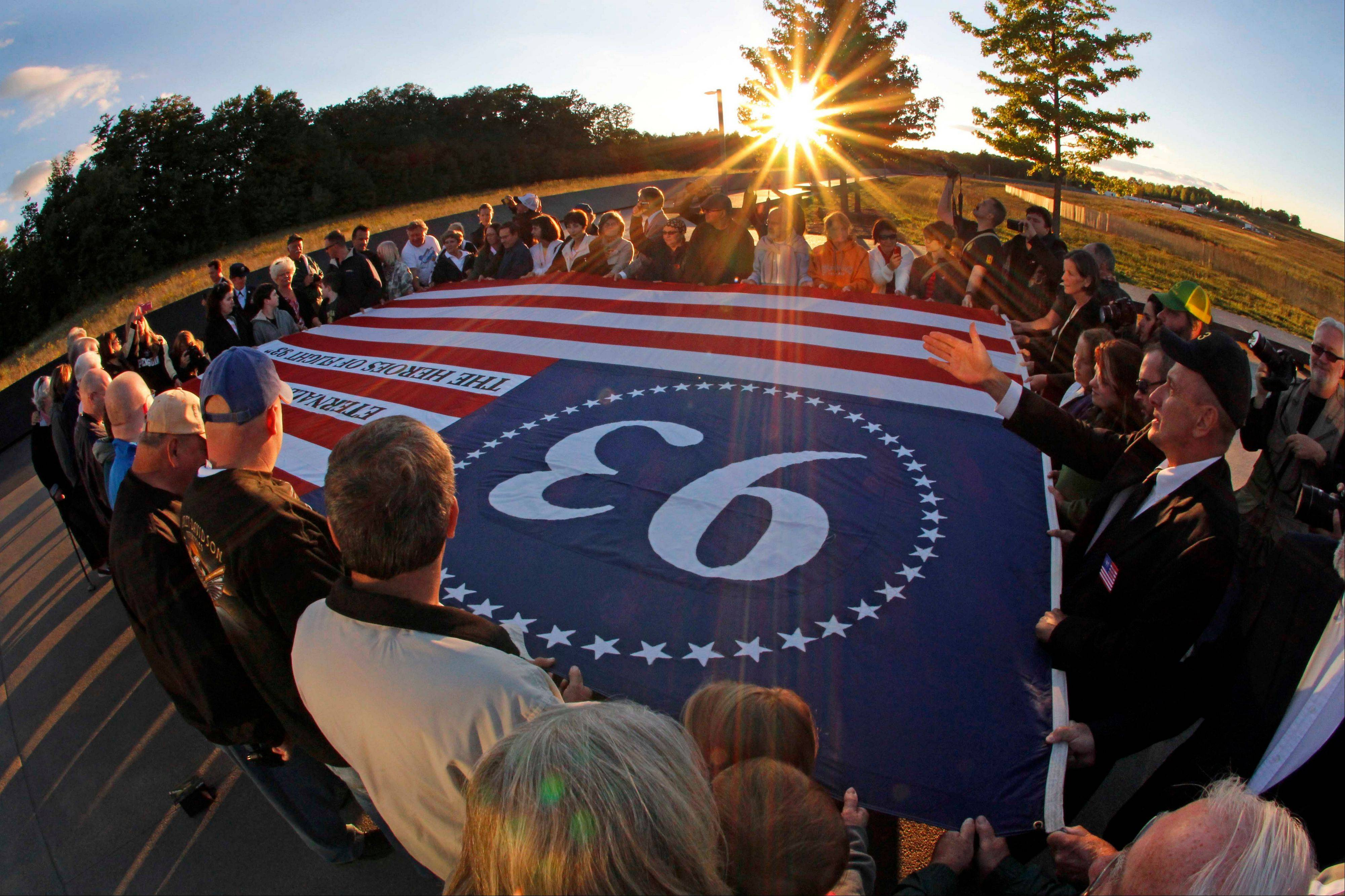 Visitors to the Flight 93 National Memorial in Shanksville, Pa., participate in a sunset memorial service on Monday. Today marks the 11th anniversary of the Sept. 11, 2001, terrorist attack.