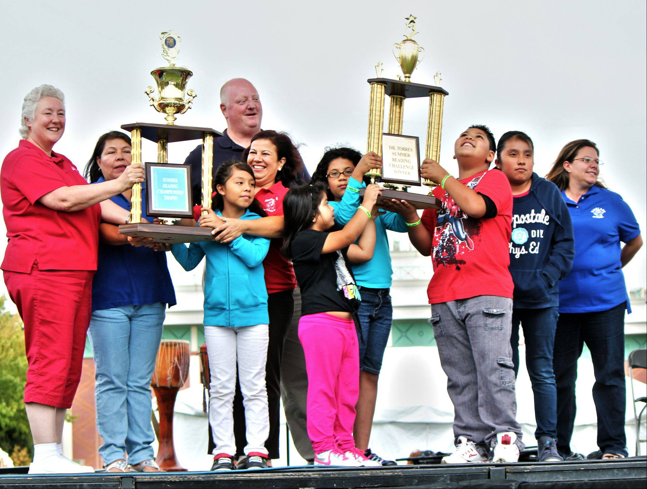 Highland Elementary School Principal Steve Johnson joins teachers and students in celebrating the school's victory in the Elgin Area School District U-46 Summer Reading Program. More than 70 percent of the school's population completed the challenge, which is sponsored by Superintendent Jose Torres.