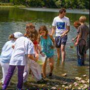 Kids stand in the Fox River to find unusual species of fish.