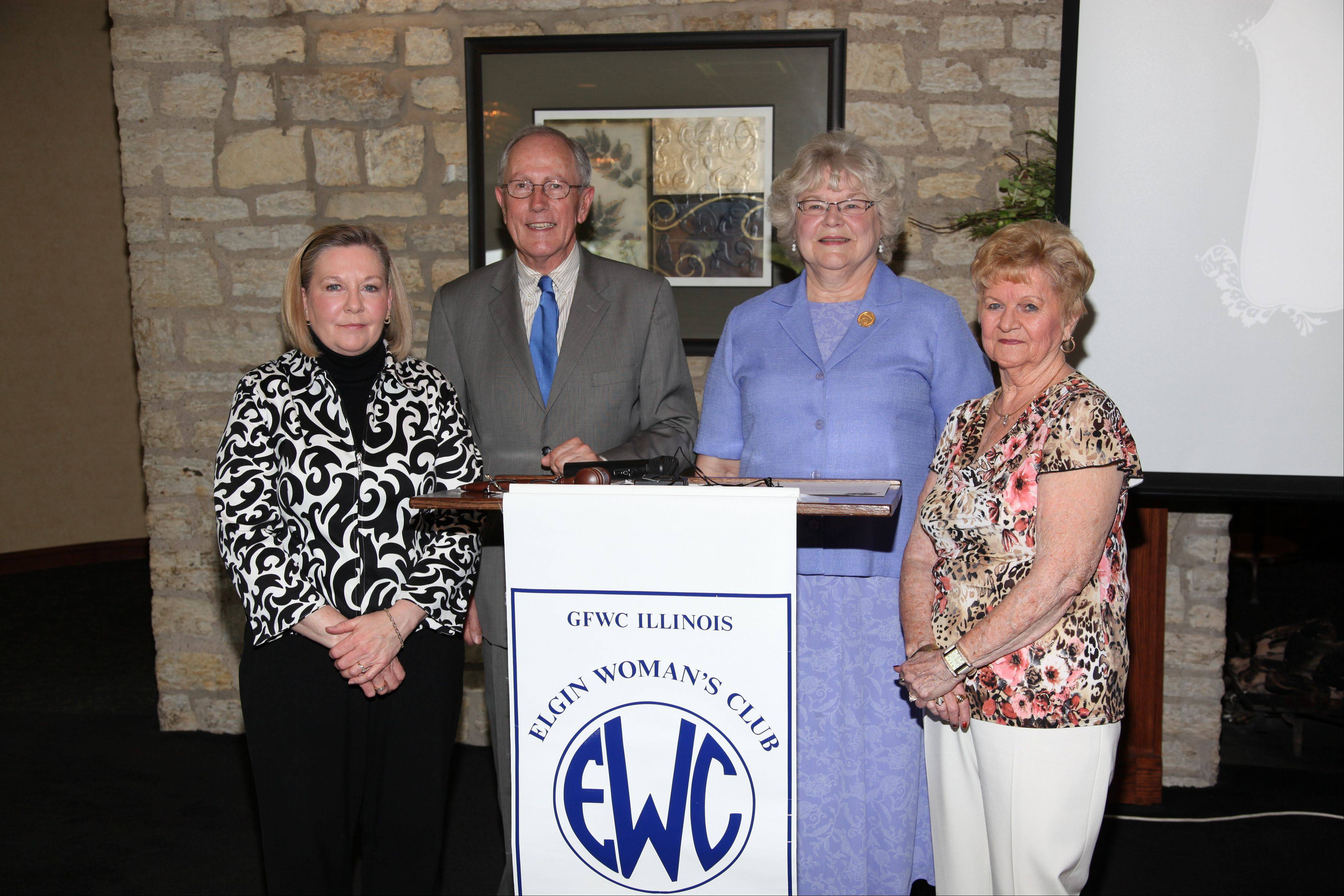 From left, Elgin Woman's Club President Linda Fagan poses with Dr. Ian Jones, vice president of clinical performance at Sherman Hospital; Pat Heitman, Illinois president of the General Federation of Women's Clubs; and Georgia Ross, past president of the Elgin Woman's Club, during a recent anniversary function.