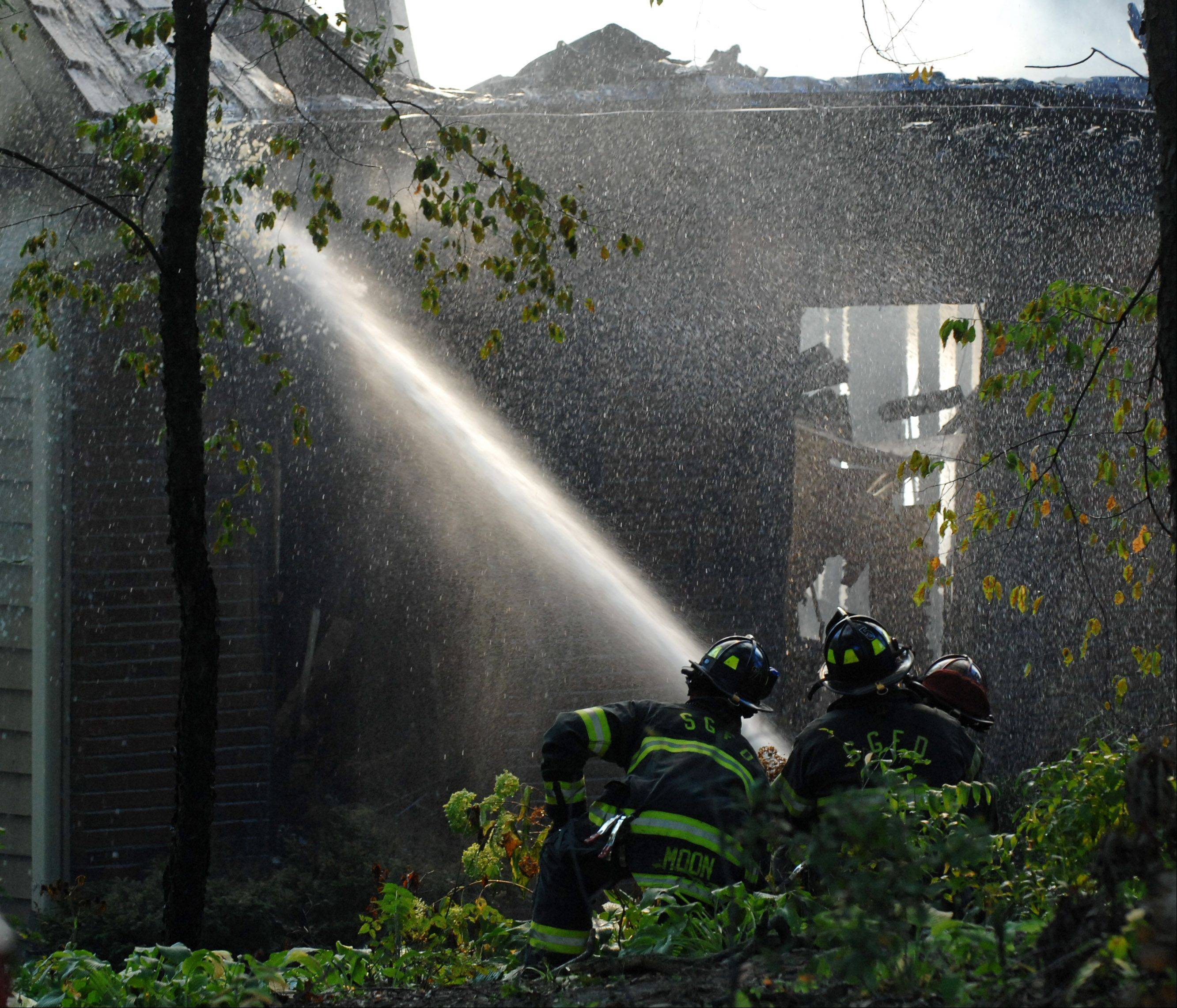 Firefighters battle an early-morning blaze Monday at a two-story home in Campton Hills.
