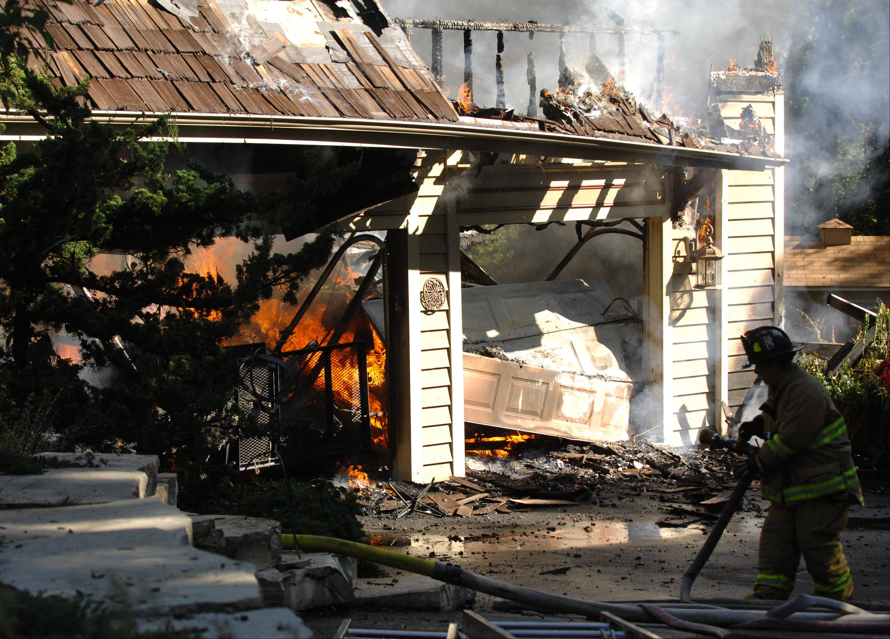 A house fire on Spring Wood Lane destroyed the two-story home Monday morning.
