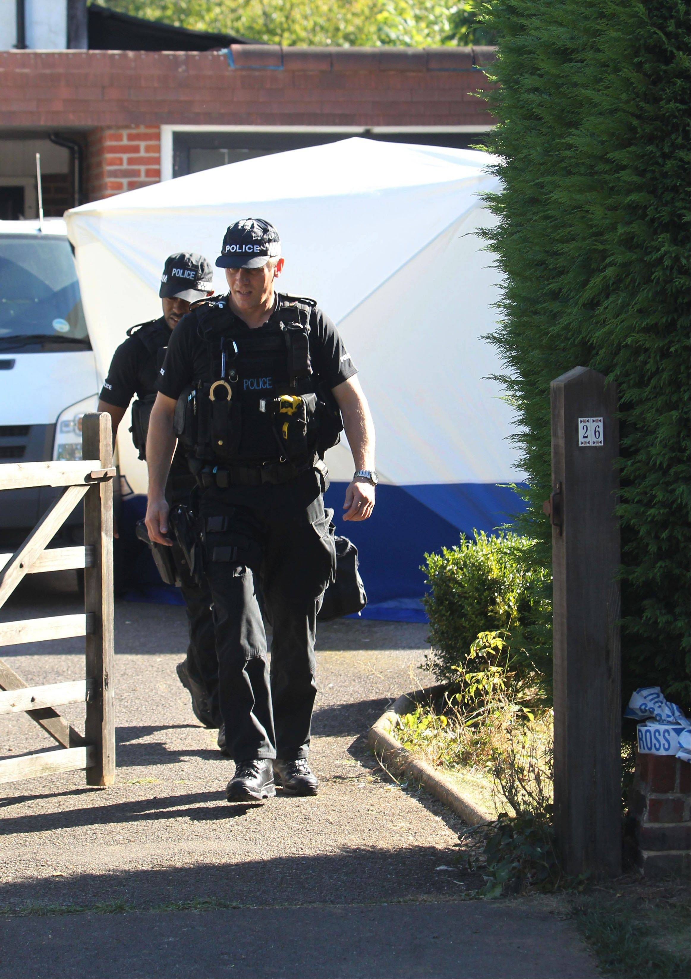 The home of Saad al-Hilli, in Claygate, England, who was shot dead on Wednesday with three others while vacationing in the French Alps, continued to be guarded Sunday by Surrey Police, who are assisting French police.