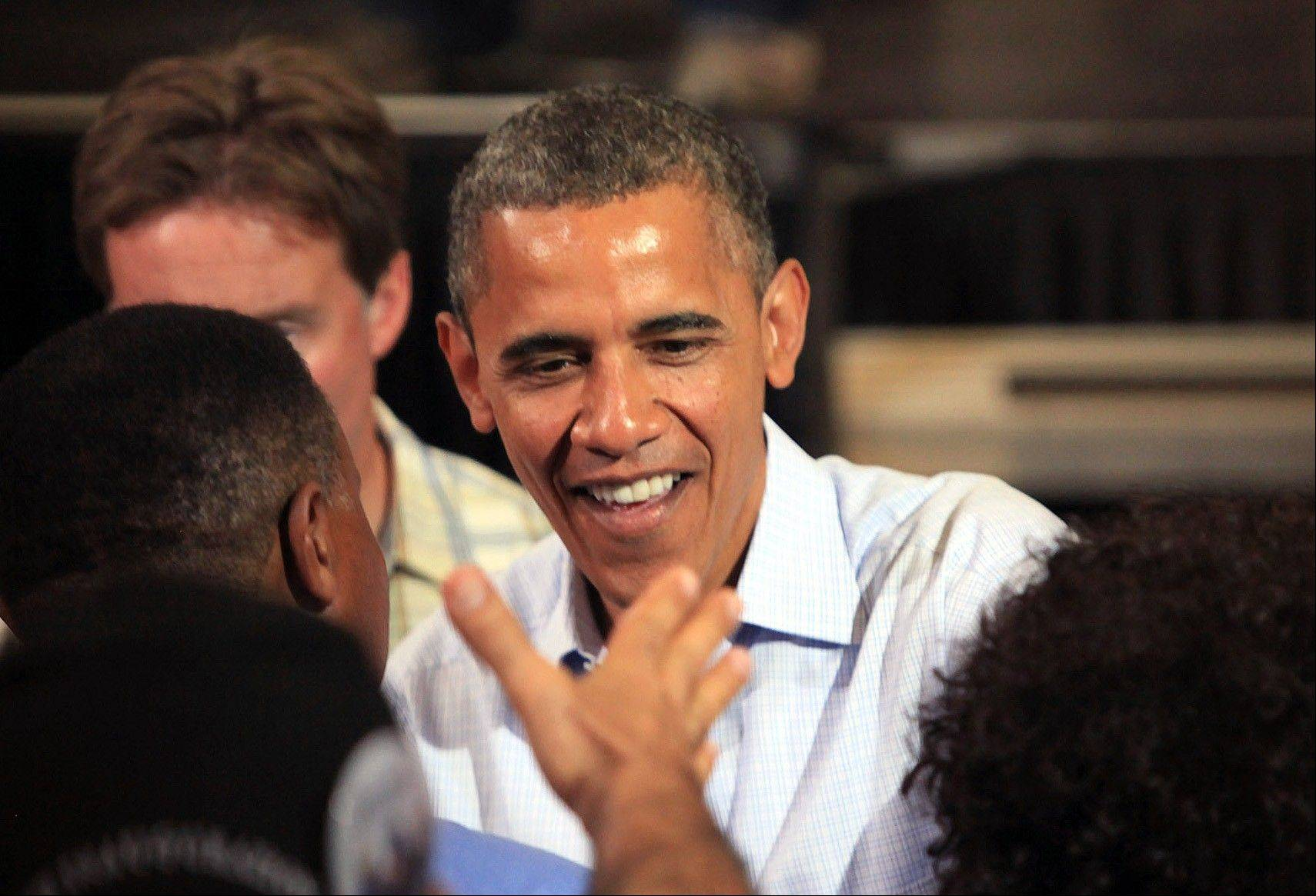 President Barack Obama greets people during a campaign stop at Florida Institute of Technology's Charles and Ruth Clemente Center in Melbourne, Fla., Sunday, Sept. 9. President Barack Obama squeaked out a fundraising victory over Mitt Romney in August.