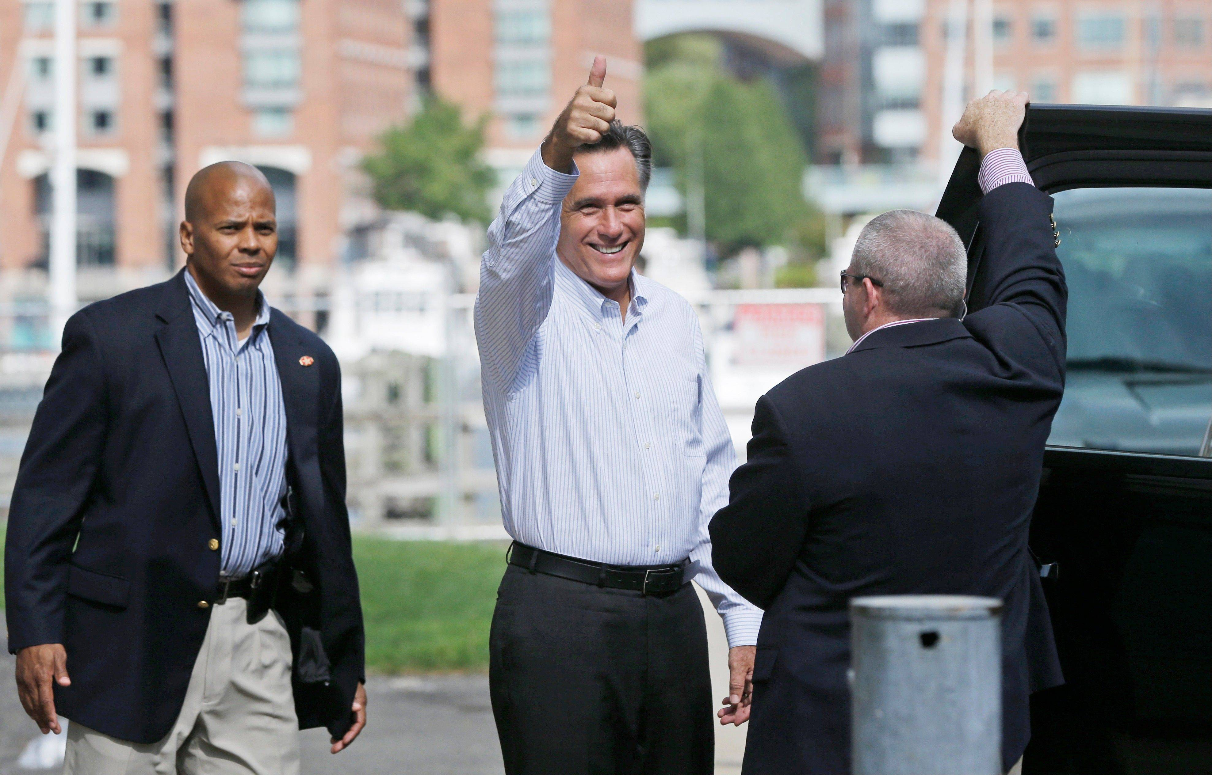 Republican presidential candidate Mitt Romney gives a thumbs-up as he leaves his campaign office in Boston on Saturday, Sept. 8.