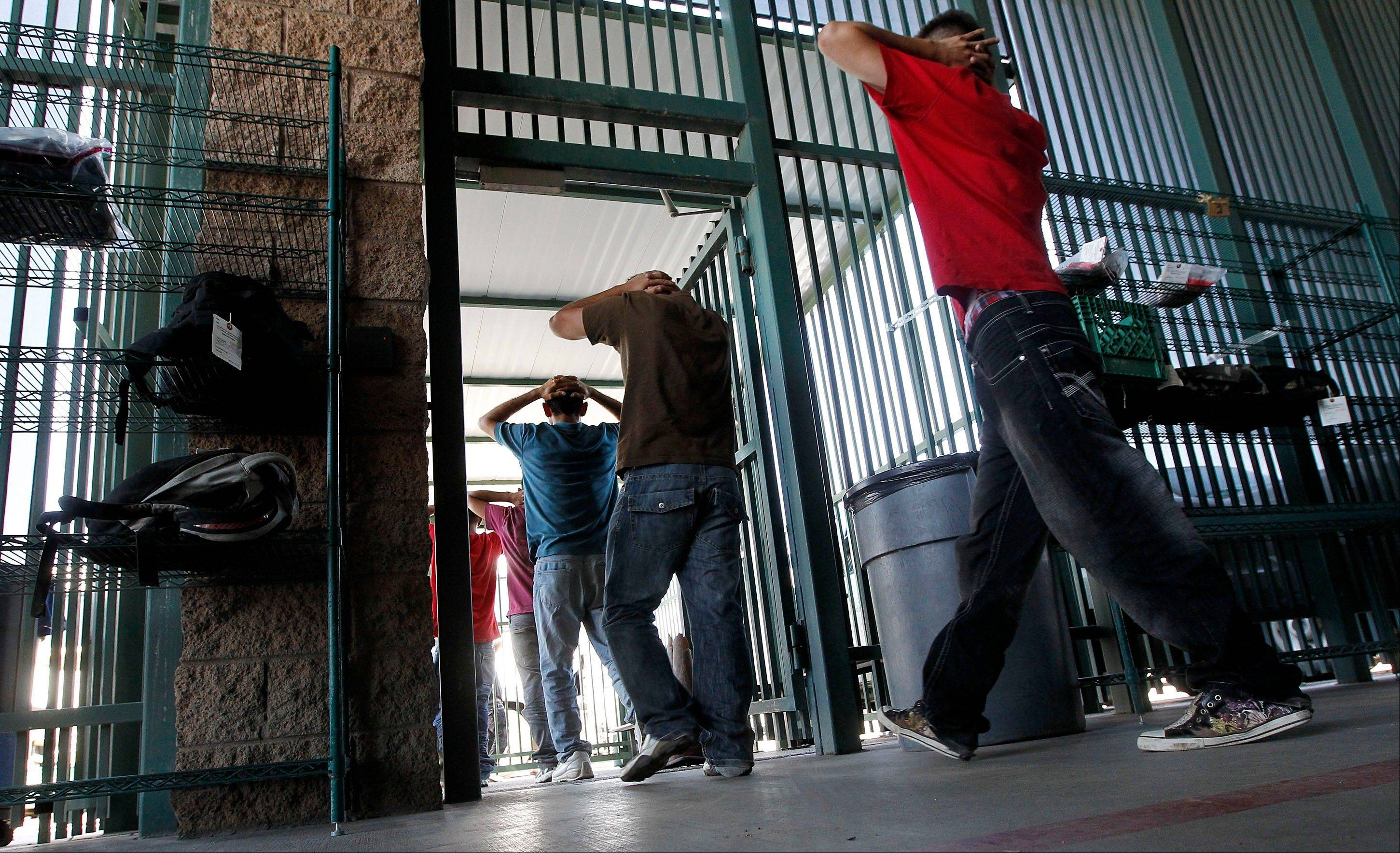 Illegal immigrants prepare to enter a bus after being processed at Tucson Sector U.S. Border Patrol Headquarters Thursday in Tucson, Ariz. New strategies being implemented by the U.S. government, including the halting of one-way flights back to the interior cities in Mexico, are in place to streamline processing and expedite a return to Mexico.