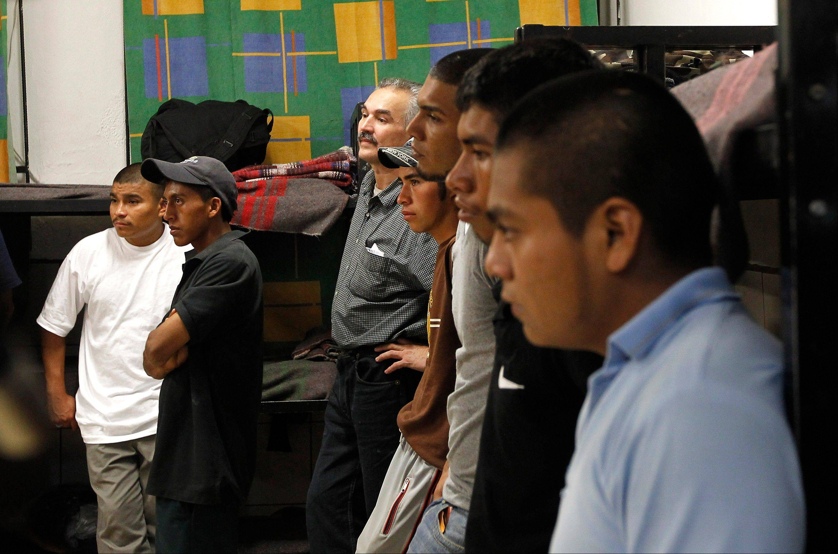 Dozens of immigrants, many of them Mexican citizens, gather in sleeping quarters at a well-known immigrant shelter, as many are making tough decisions on whether to try their luck at trying to make it to the United States, by illegally crossing the border, Thursday, Aug. 9, in Nogales, Mexico. The U.S. government has halted flights home for Mexicans caught entering the country illegally in the deadly summer heat of Arizona's deserts.