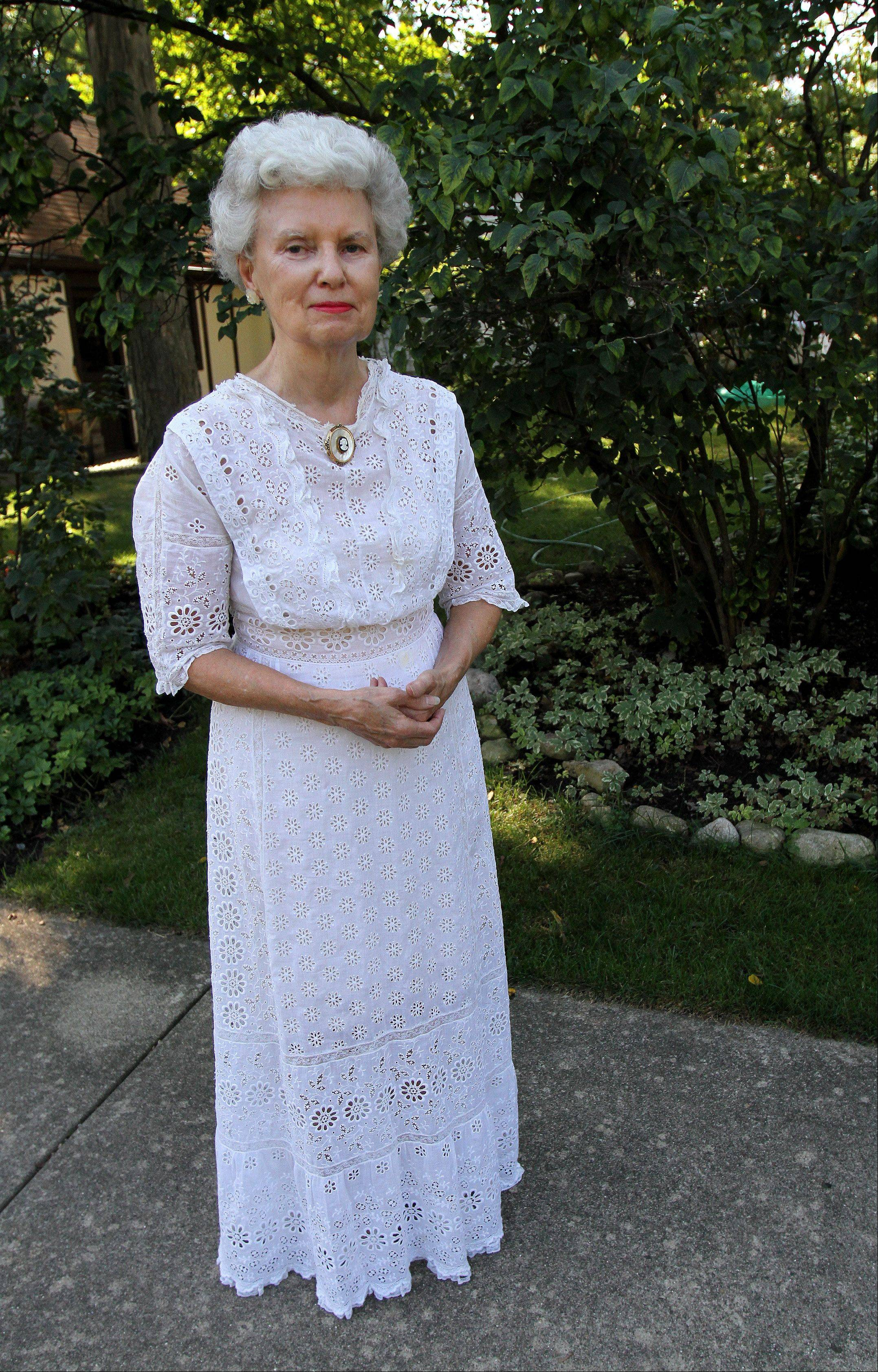 Carol Miller of Glen Ellyn will wear her husband's great-grandmother's wedding dress from 1860 when she gives a presentation on the history of the Glen Ellyn Woman's Club on Tuesday, Sept. 11.