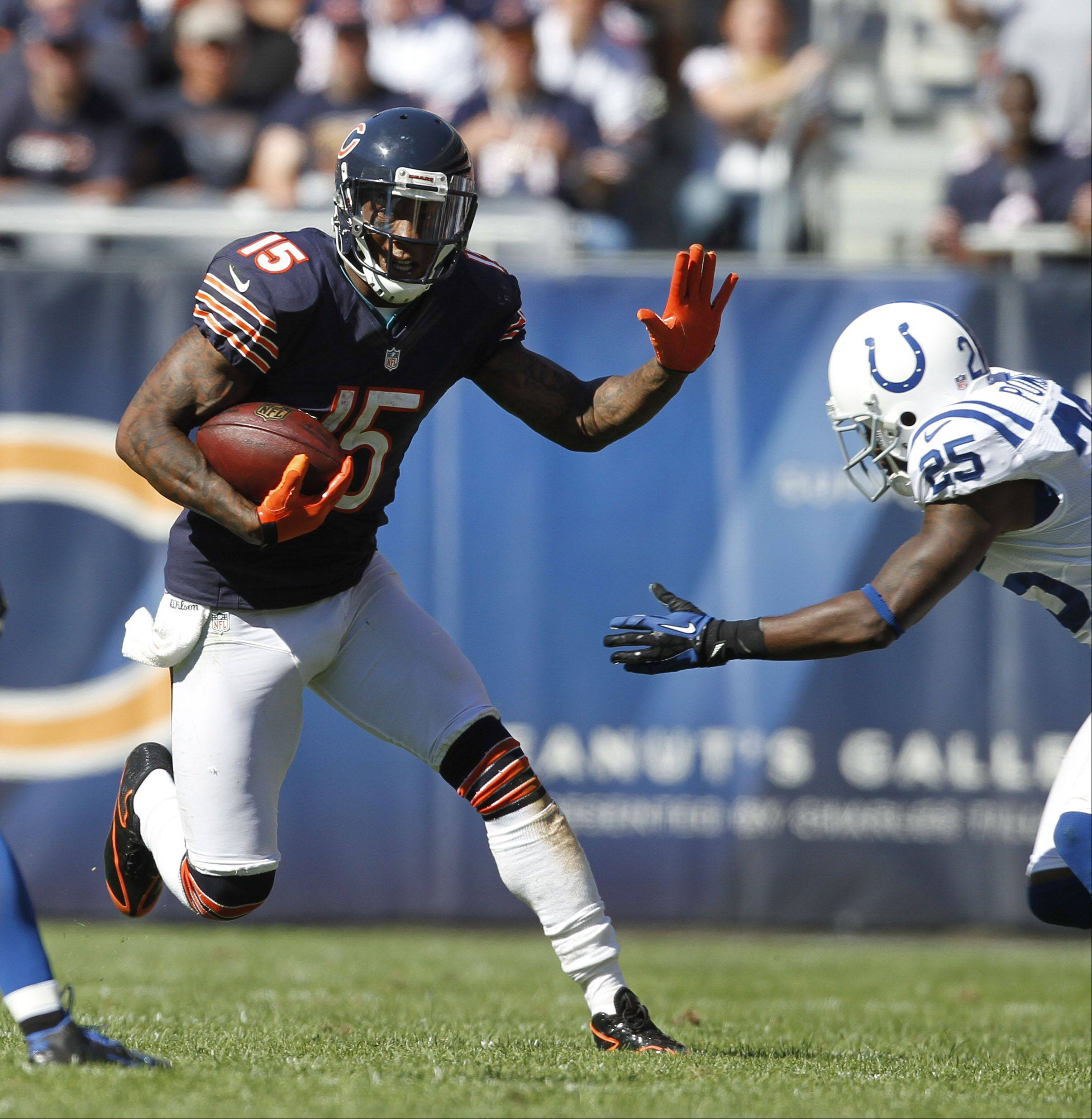 Chicago Bears wide receiver Brandon Marshall, left, runs past Indianapolis Colts cornerback Jerraud Powers during the Bears season opener against the Indianapolis Colts Sunday at Soldier Field in Chicago. The Bears won 41-21.