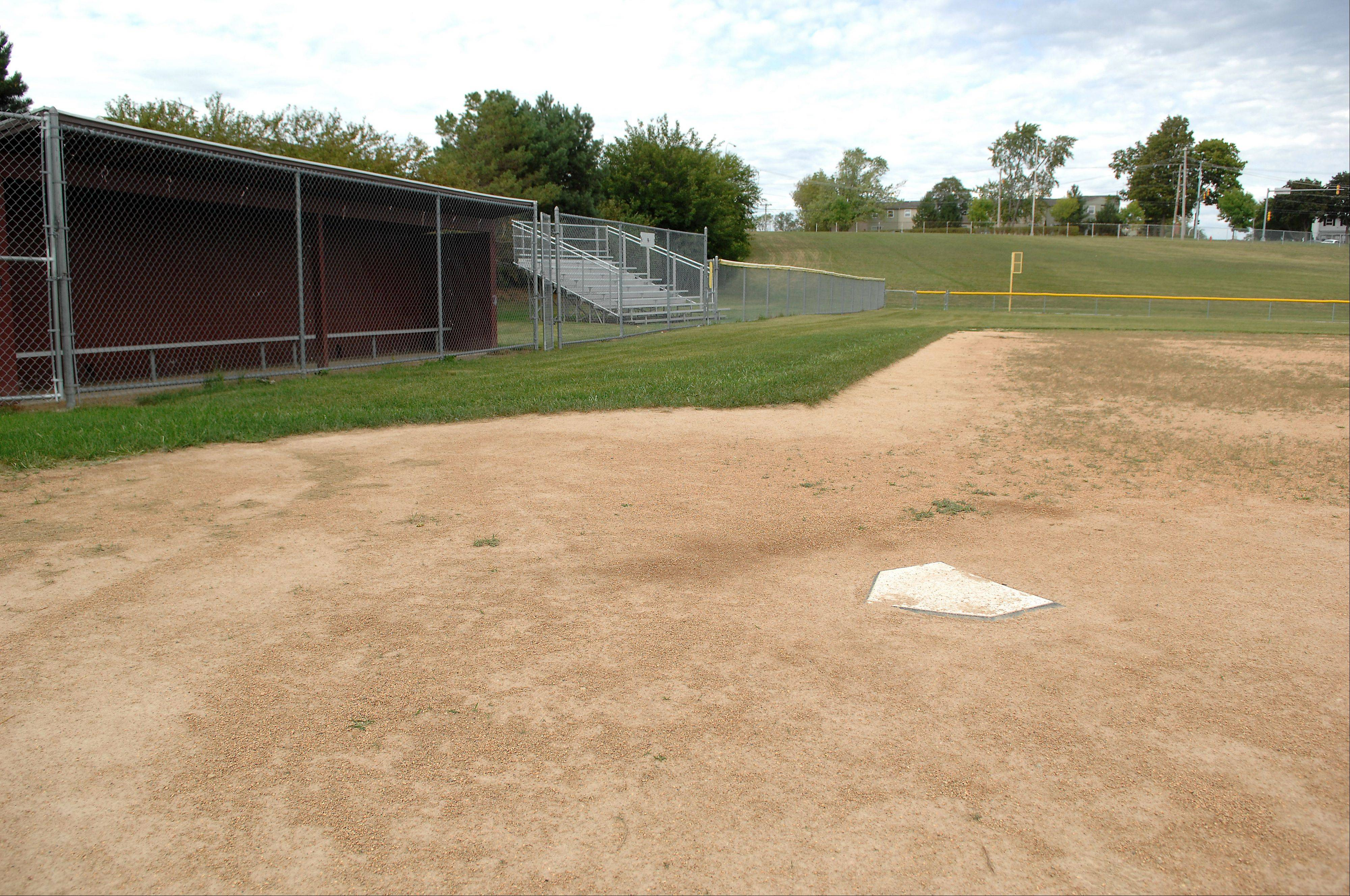 The Elgin High School softball field has dugouts and fences as a result of a Title IX lawsuit filed in 2001.