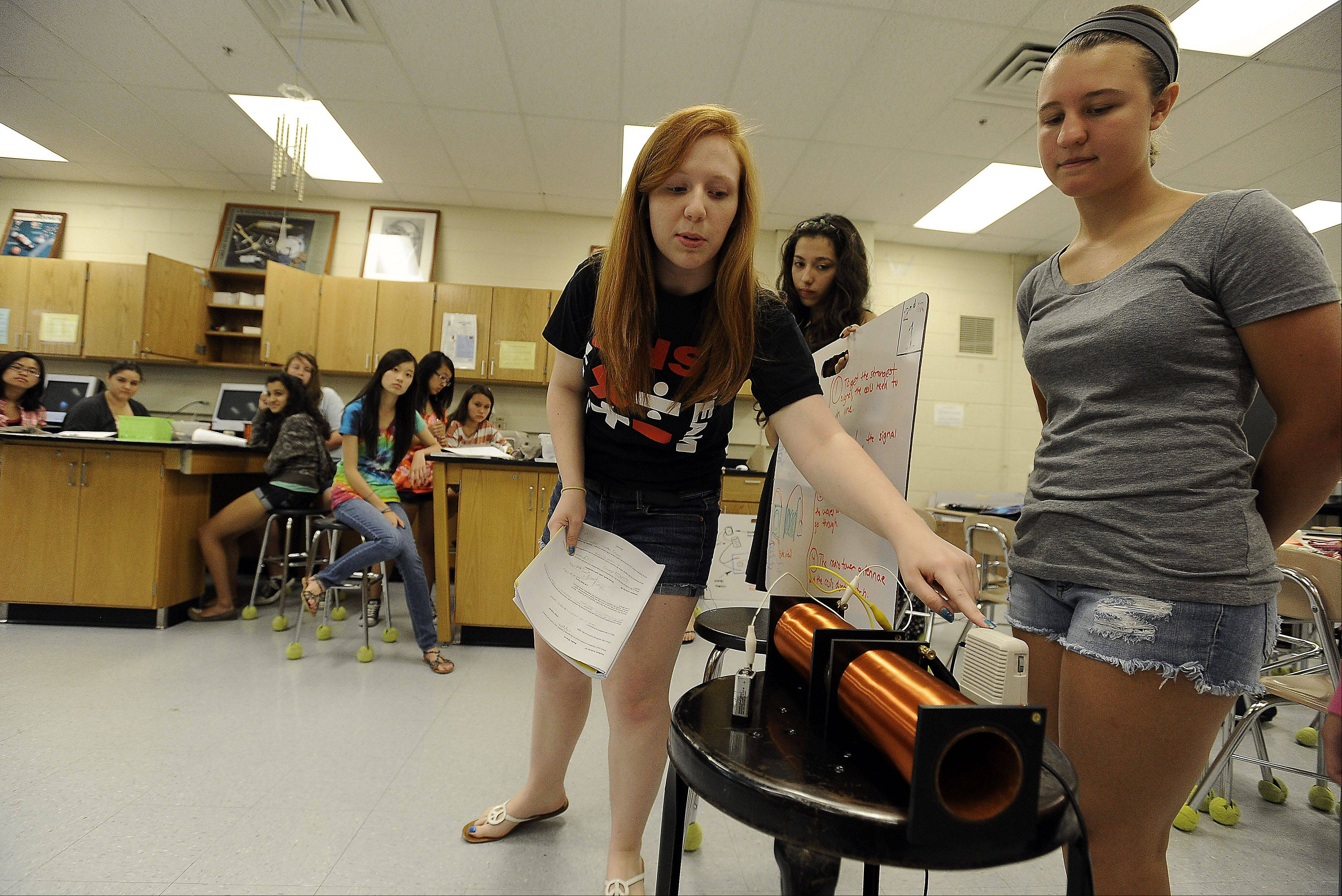 Courtney Wilt, 16, of Inverness explains her physics project to her fellow classmates as her project partner Leah Thomas, 16, of Barrington looks on during summer school at Barrington High School.