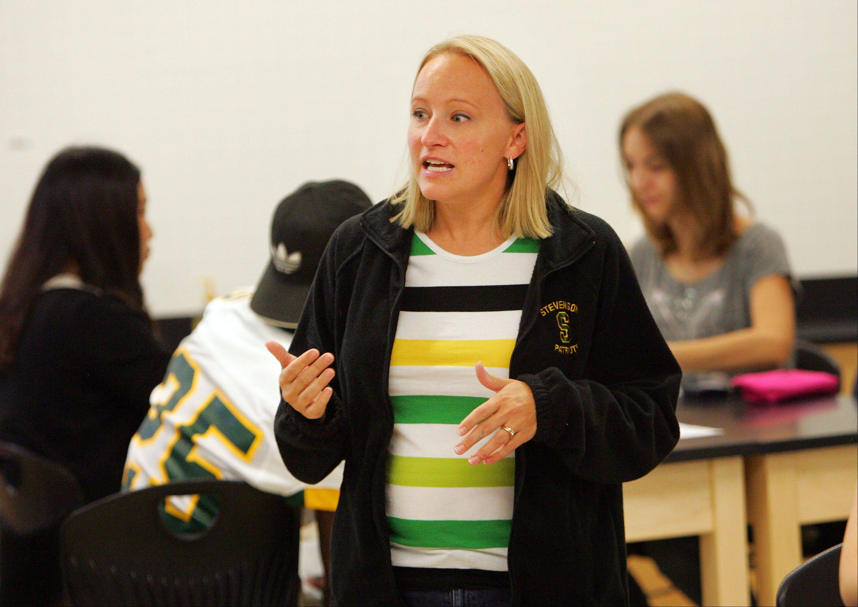 College prep biology teacher Lill Lisius runs her class at Stevenson High School in Lincolnshire.