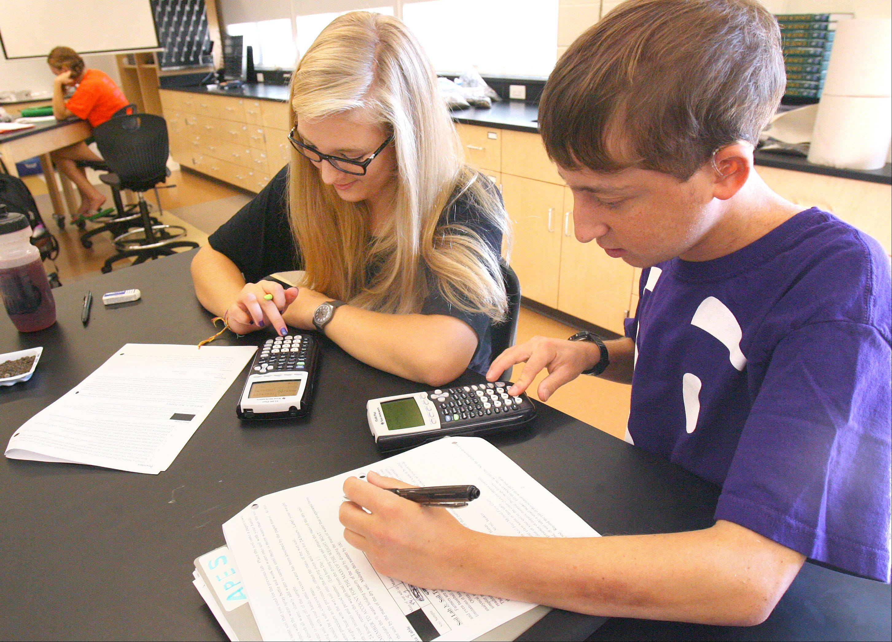 Katja Sandquist, 17, of Long Grove, left, and Daniel Sagerman, 17, of Buffalo Grove solve problems during an Advanced Placement environmental science class at Stevenson High School.