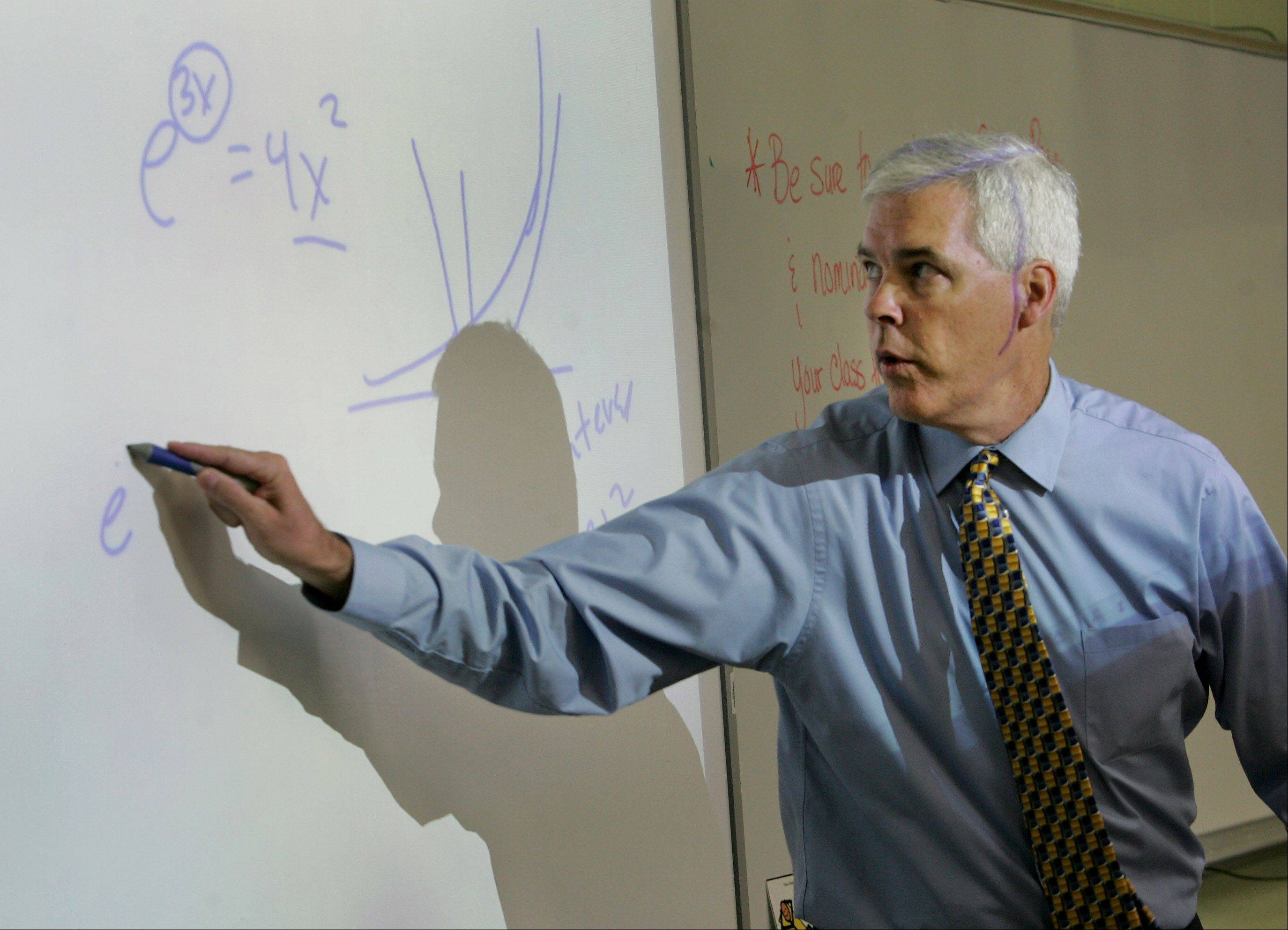 Bill Yanisch teaches 27 students in an Advanced Placement calculus class at Neuqua Valley High School in Naperville.