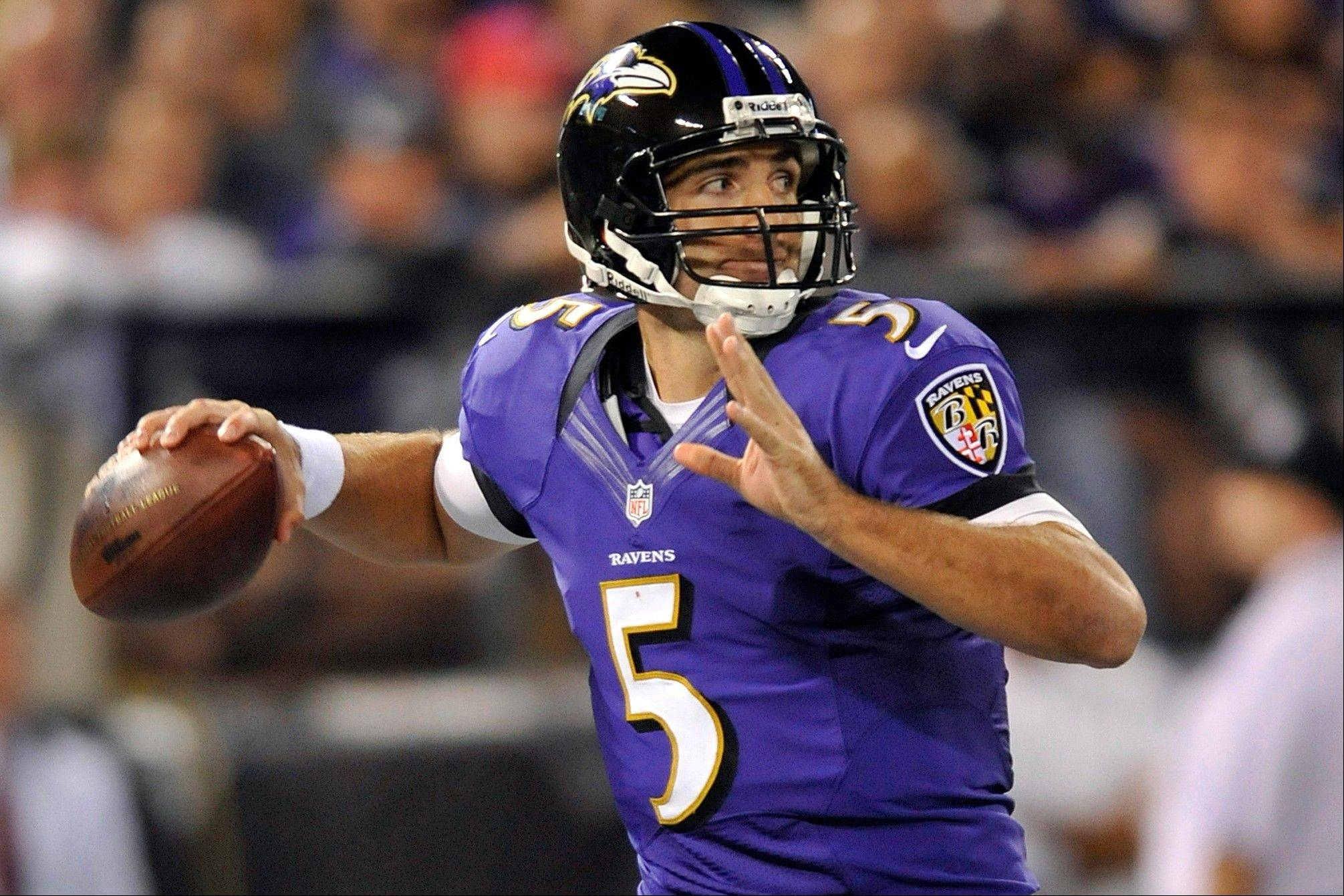 Ravens quarterback Joe Flacco throws to a receiver in the second half Monday against the Cincinnati Bengals in Baltimore.
