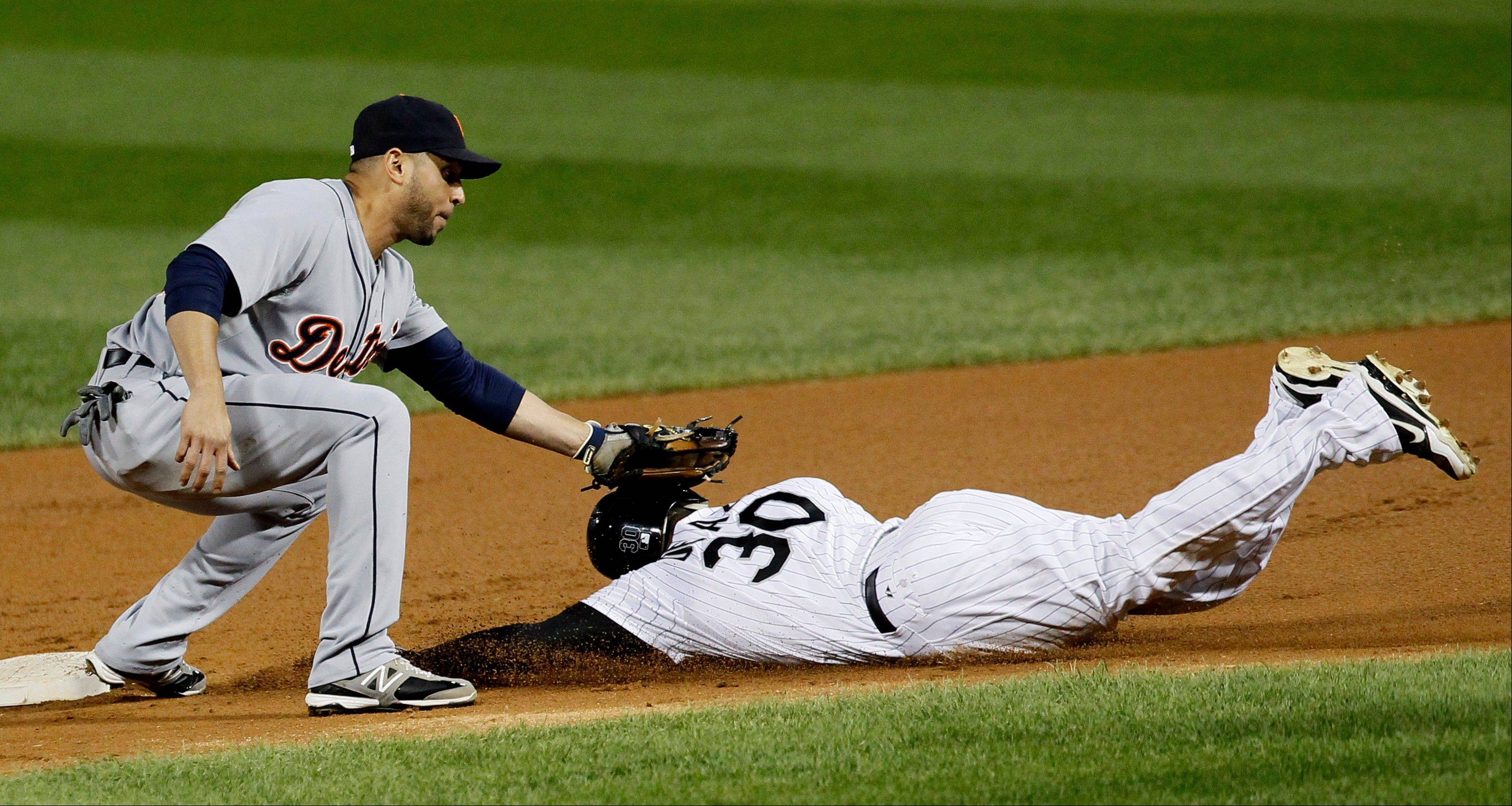 Tigers second baseman Omar Infante appears to tag Alejandro De Aza on the head, but De Aza was called safe stealing second by umpire Todd Tichenor, during the first inning Monday at U.S. Cellular Field.