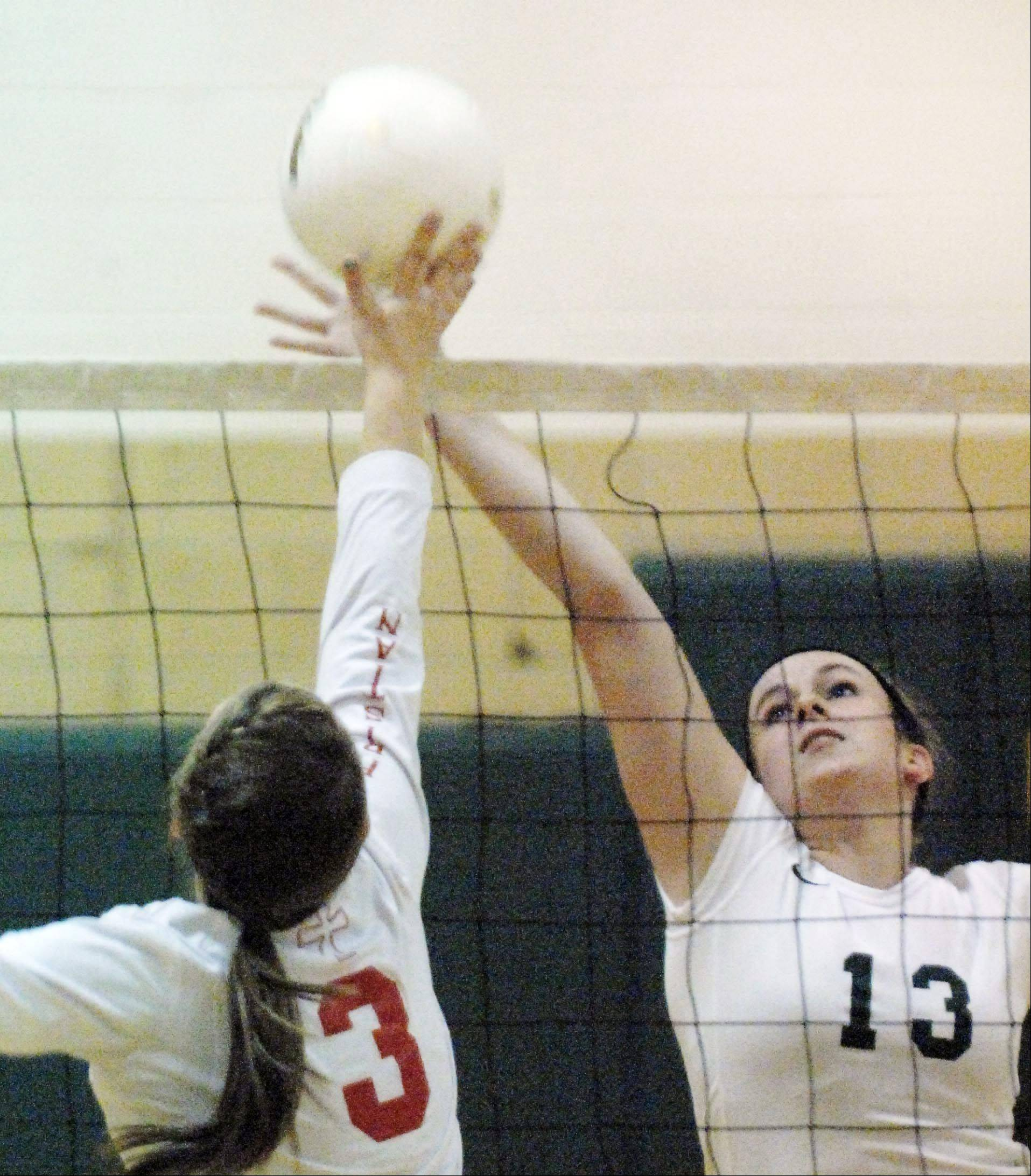 St. Edward's Cory Kelly tries to get to the ball before Aurora Christian's Jamie Gebauer taps it away Monday in Elgin.