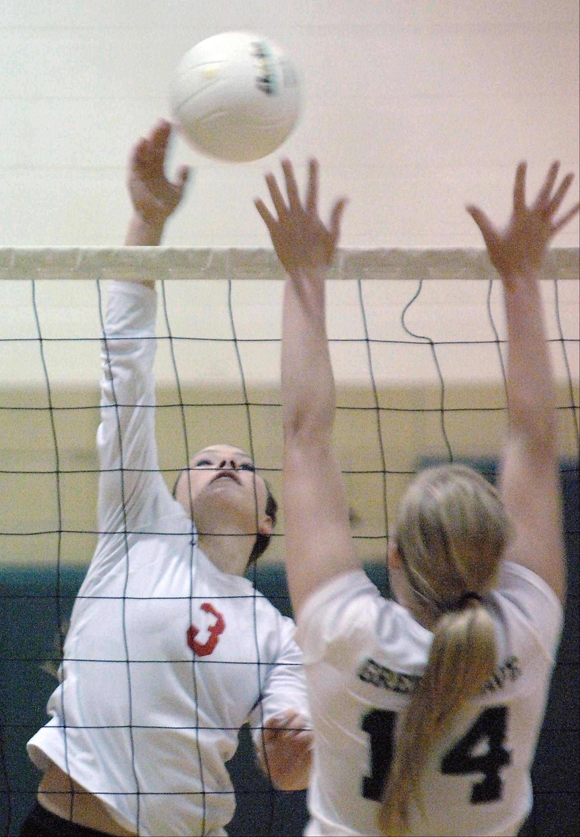 Aurora Christian's Danielle Huseman hits against St. Edward's Shannon Igielski Monday in Elgin.