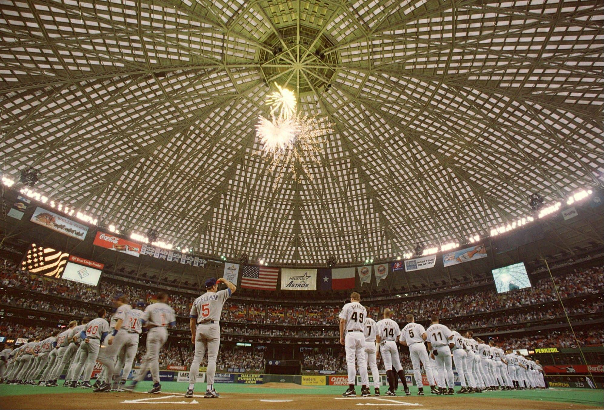 Fireworks explode in the Astrodome as the Cubs, left, and Houston Astros lined up before the start of the last season opener to be played in the Astrodome, Tuesday, April 6, 1999, in Houston.