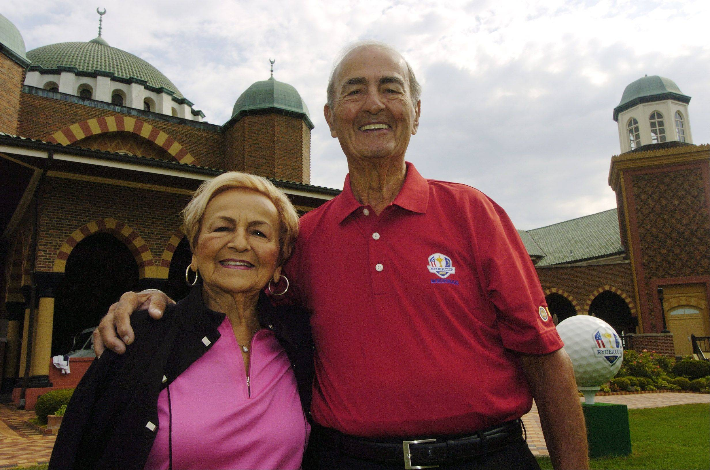 JOE LEWNARD/jlewnard@dailyherald.comBertha, 87, and Peter Broustis, soon to turn 89, of Park Ridge will be the oldest volunteers working at the Ryder Cup golf tournament at the Medinah Country Club later this month.