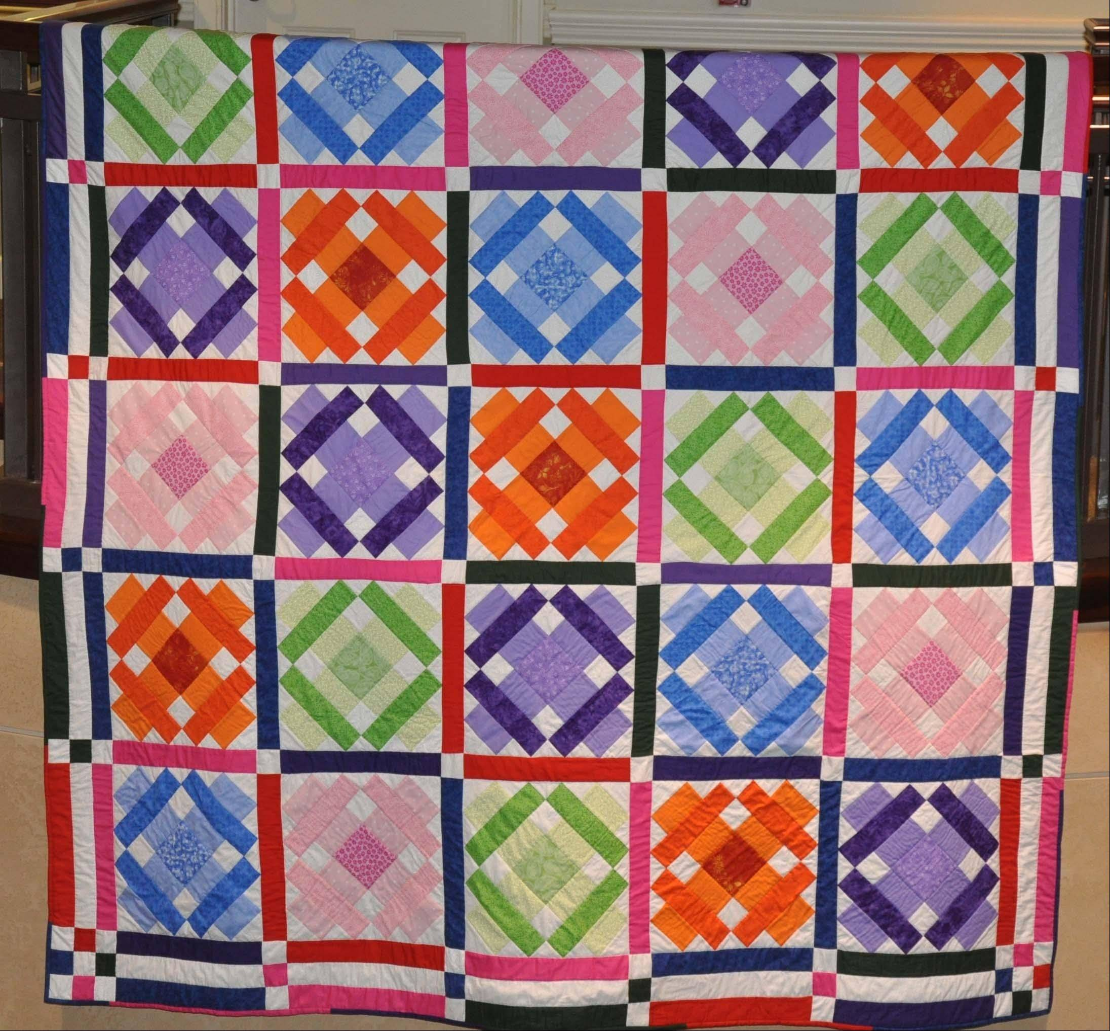 The featured 2012 Holmstad Bazaar quilt, made by resident quilters.