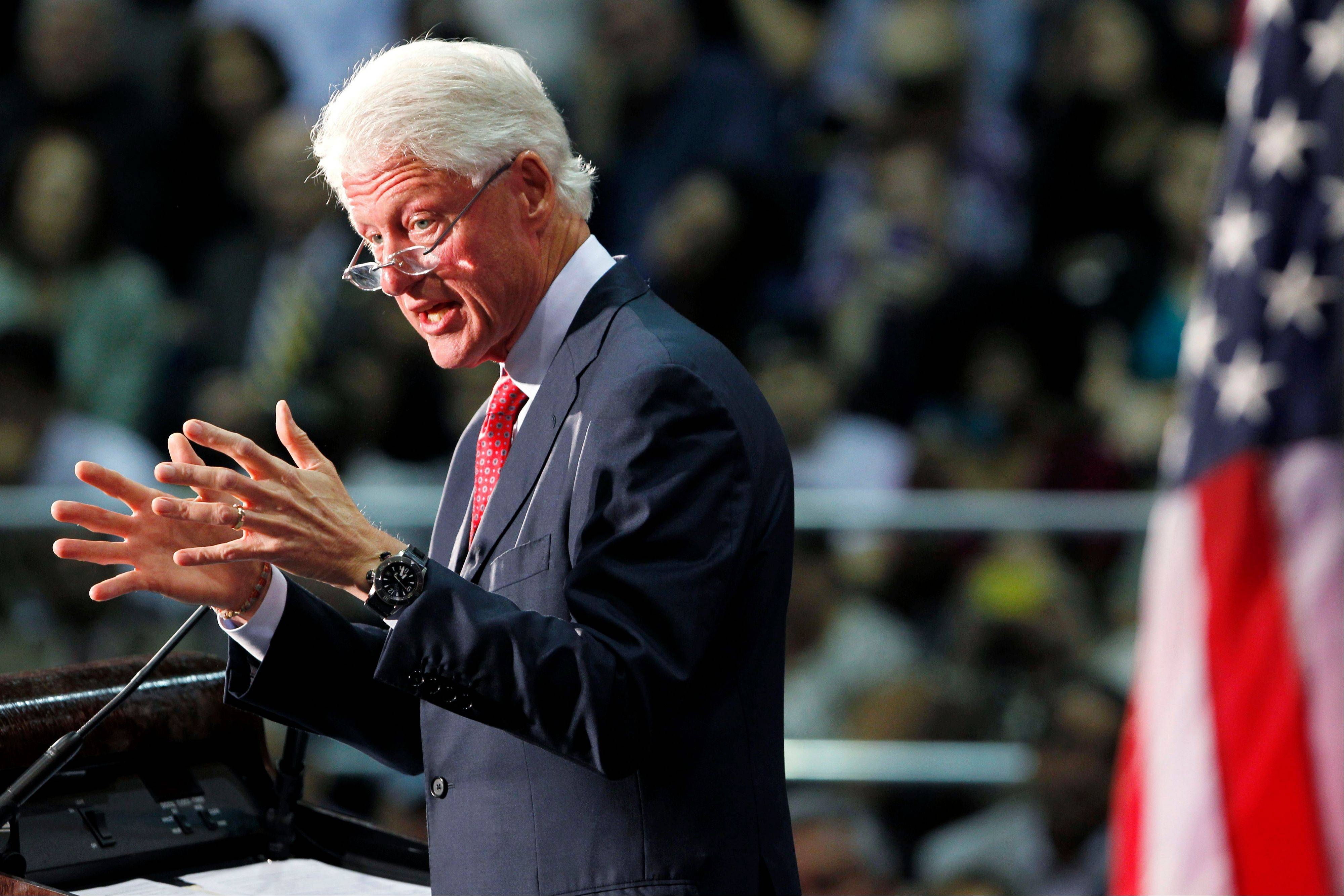 Former President Bill Clinton gestures Tuesday as he speaks at Florida International University.