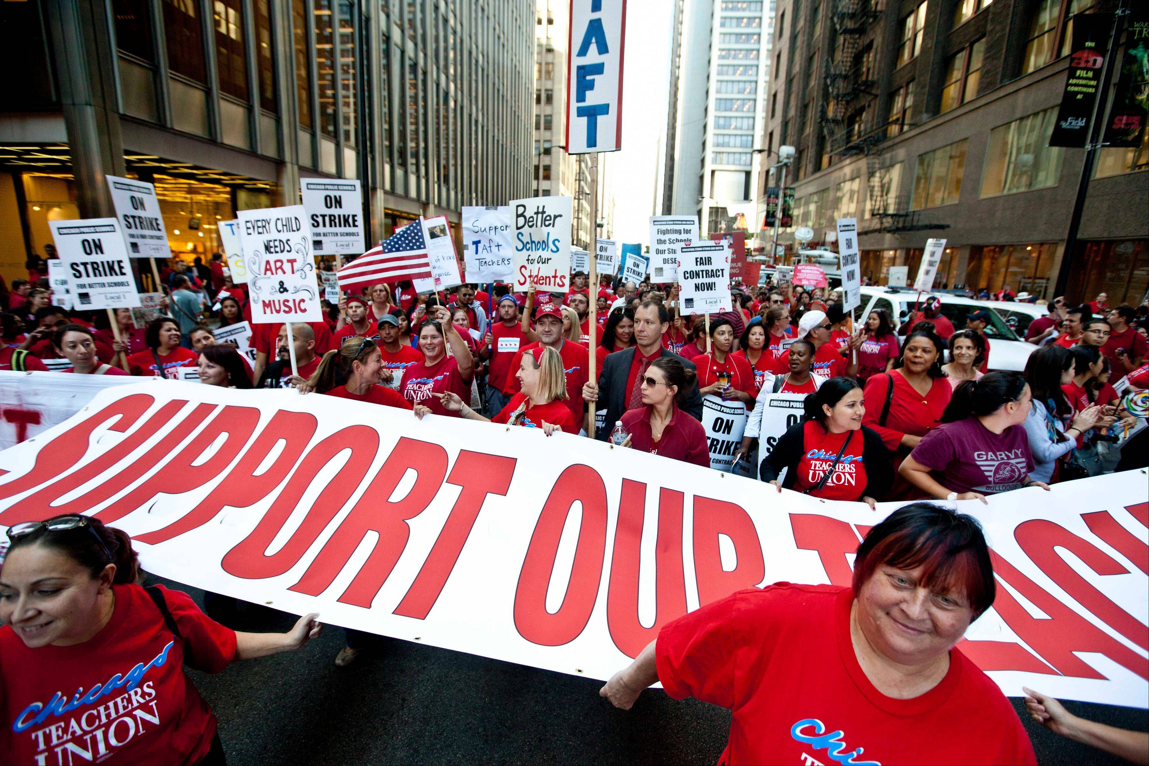 Thousands of public school teachers rally outside Chicago Public Schools district headquarters on the first day of strike action over teachers' contracts on Monday, Sept. 10, 2012 in Chicago.