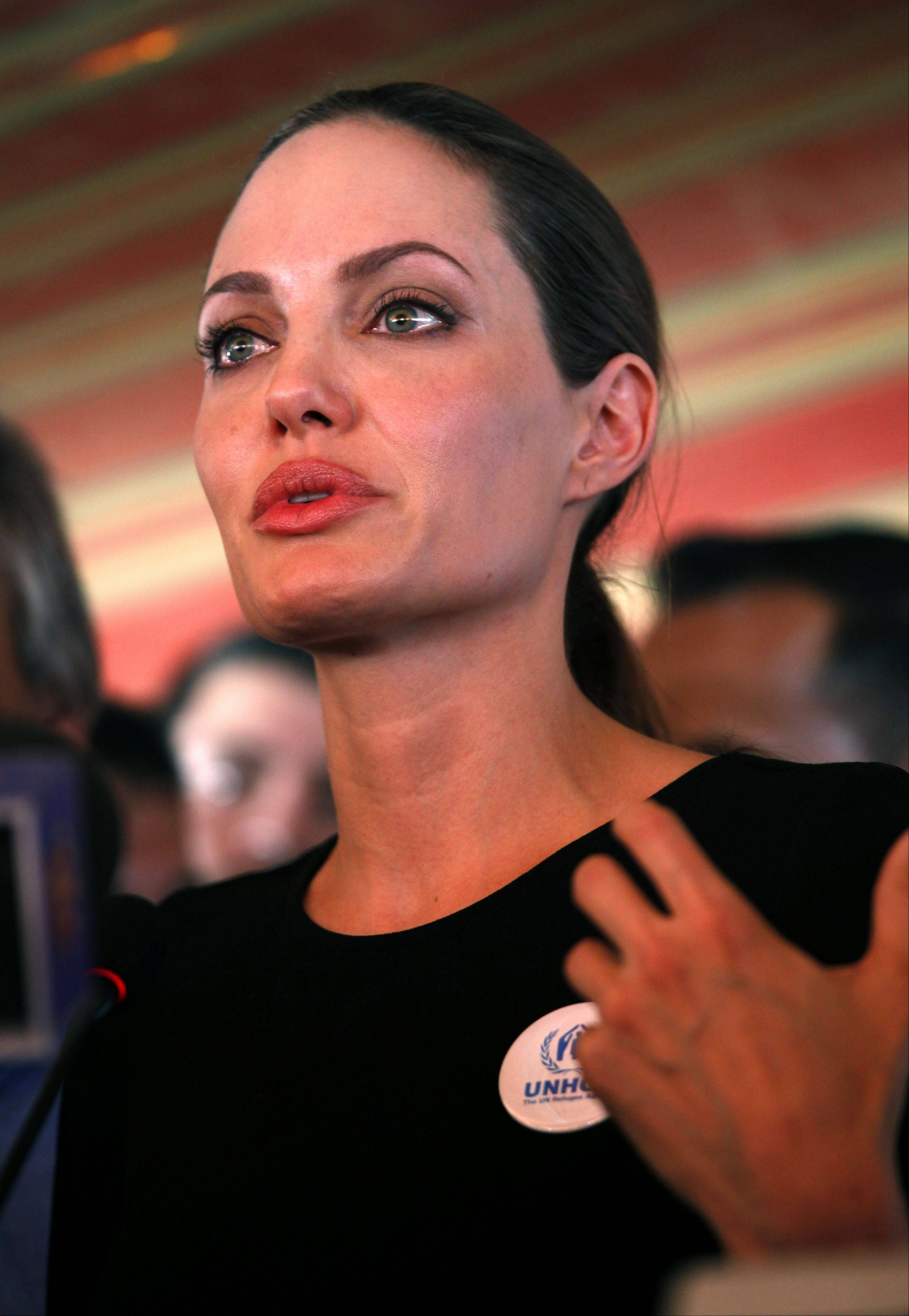 The U.N. refugee agency's special envoy, actress Angelina Jolie, speaks to the press during her visit to the Zaatari Syrian Refugees Camp, in Mafraq, Jordan, Tuesday, Sept. 11, 2012. The Hollywood star arrived on Tuesday morning in the Zaatari camp, which hosts about 27,000 Syrians displaced by the 18-month conflict.