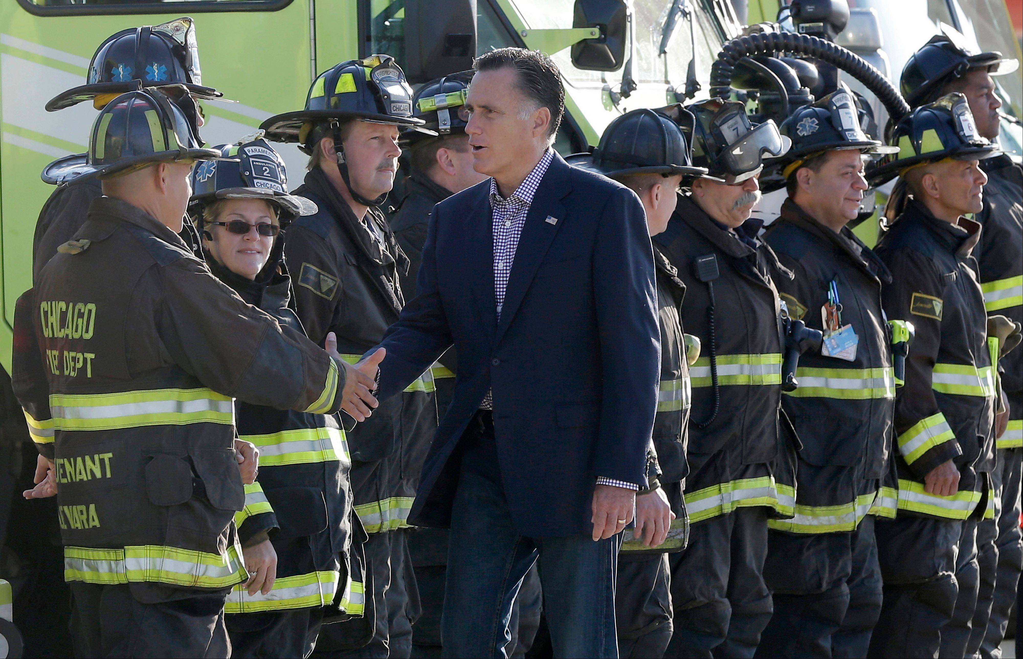 Republican presidential candidate Mitt Romney greets firefighters at Chicago O'Hare International Airport, Tuesday, Sept. 11, 2012.