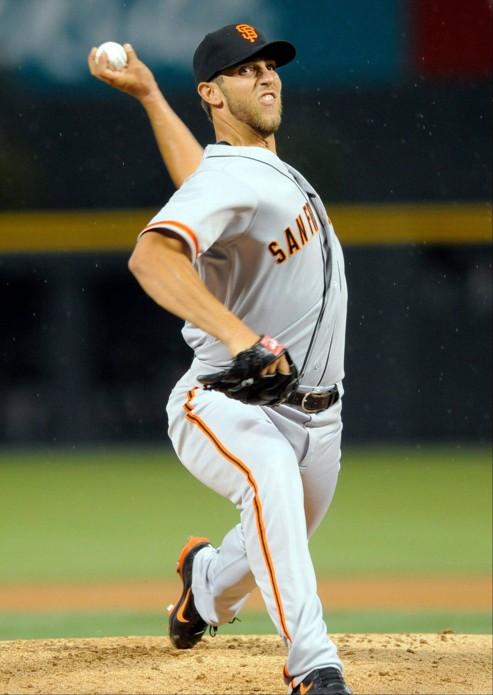 San Francisco Giants starting pitcher Madison Bumgarner was roughed up by the Rockies, allowing five runs and 11 hits in 4 1-3 innings on Tuesday in Denver.
