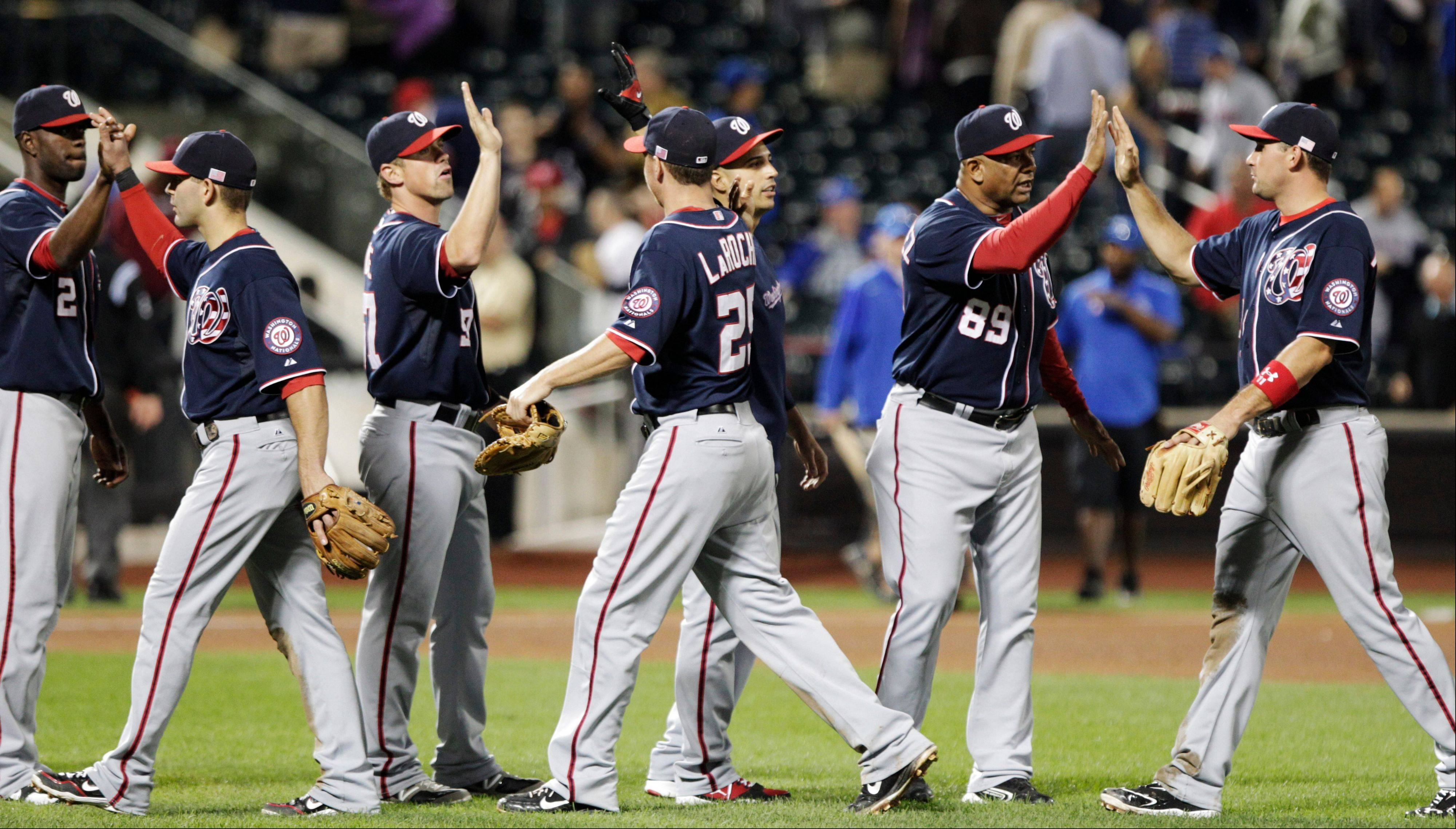 The Nationals celebrate their win against the Mets on Tuesday in New York.