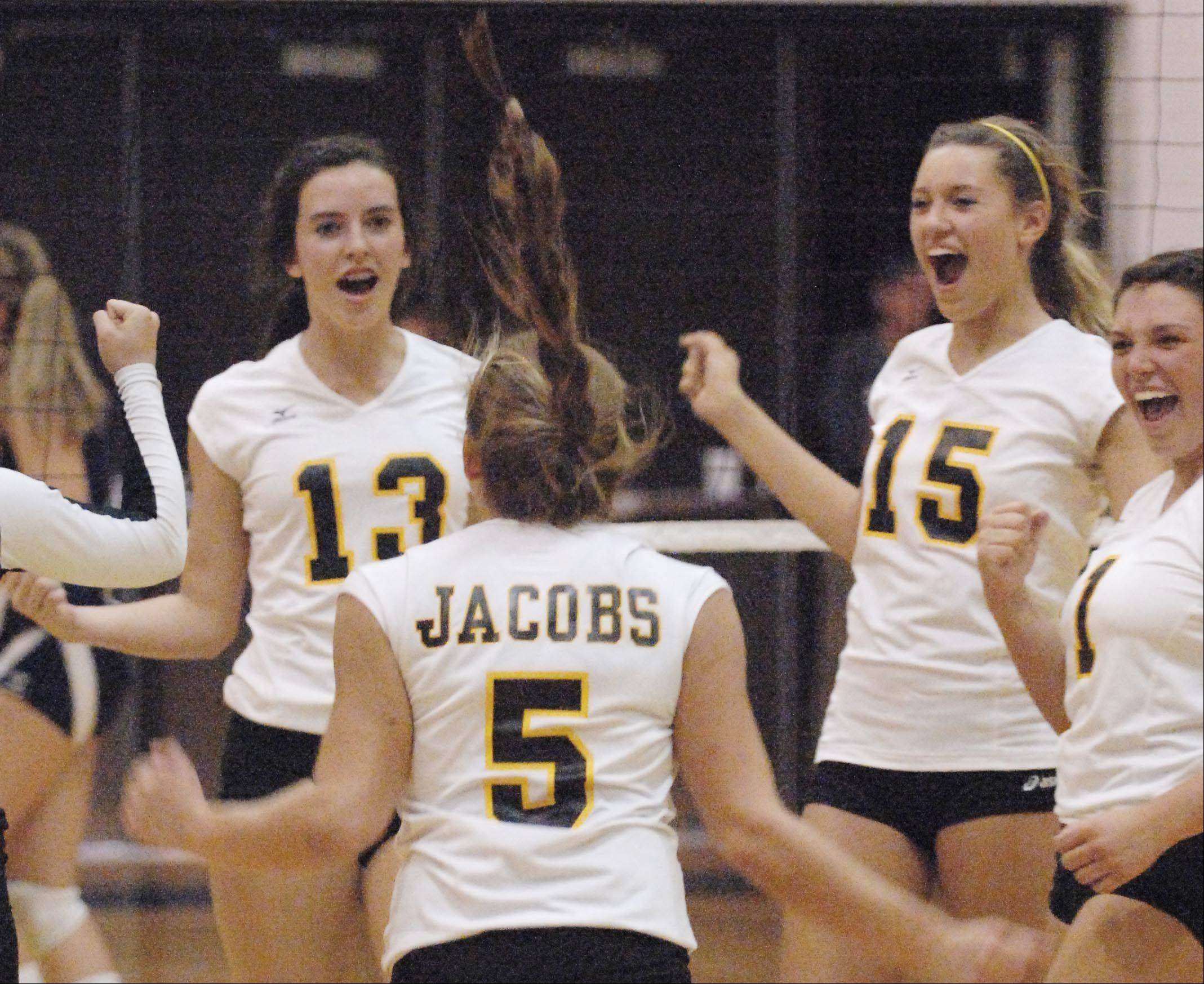 Jacobs celebrates a point against Cary-Grove Tuesday in Cary.