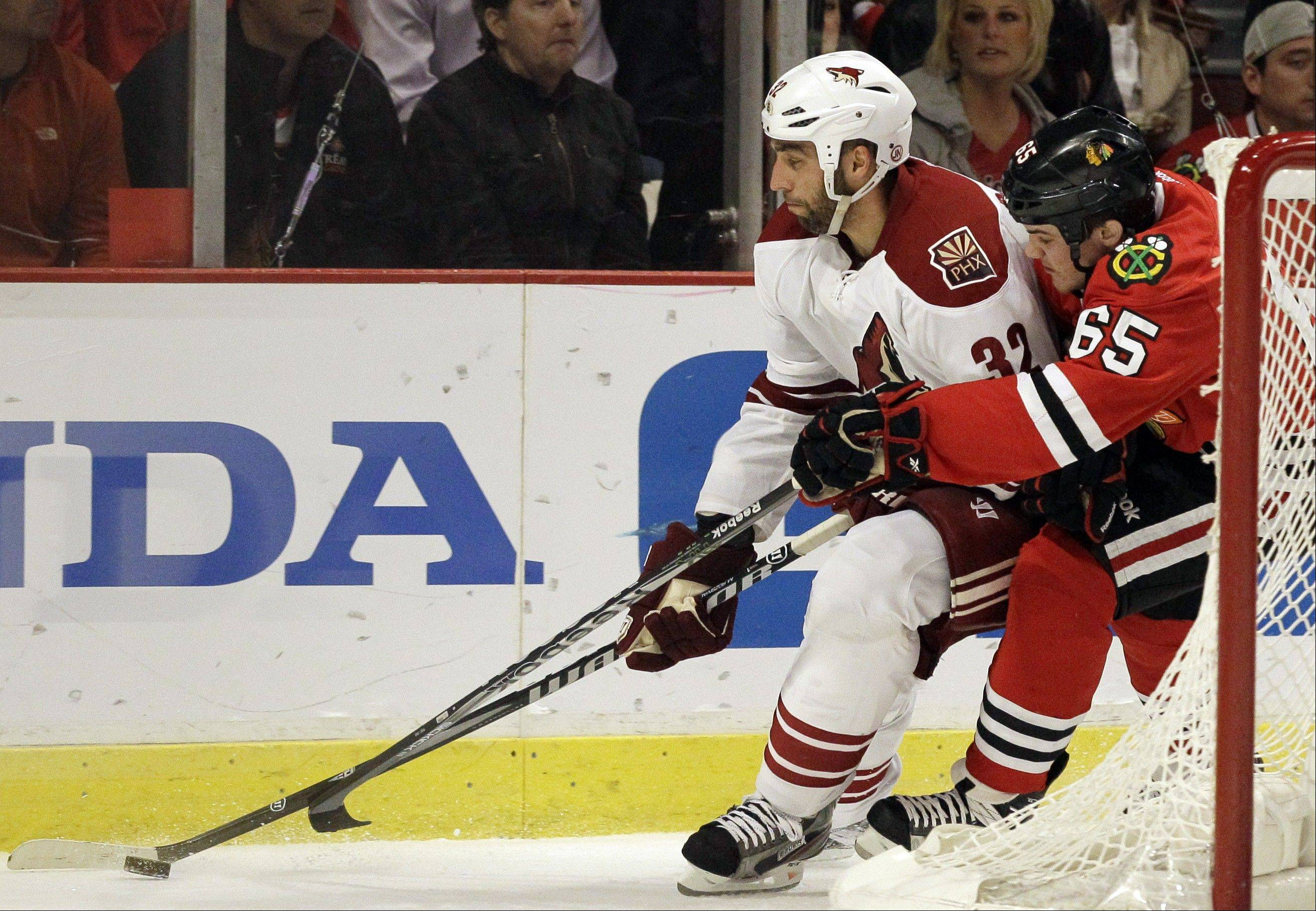 Former Phoenix Coyotes defenseman Michal Rozsival (32), here battling Andrew Shaw in the 2012 playoffs, has agreed to a one-year deal with the Blackhawks.