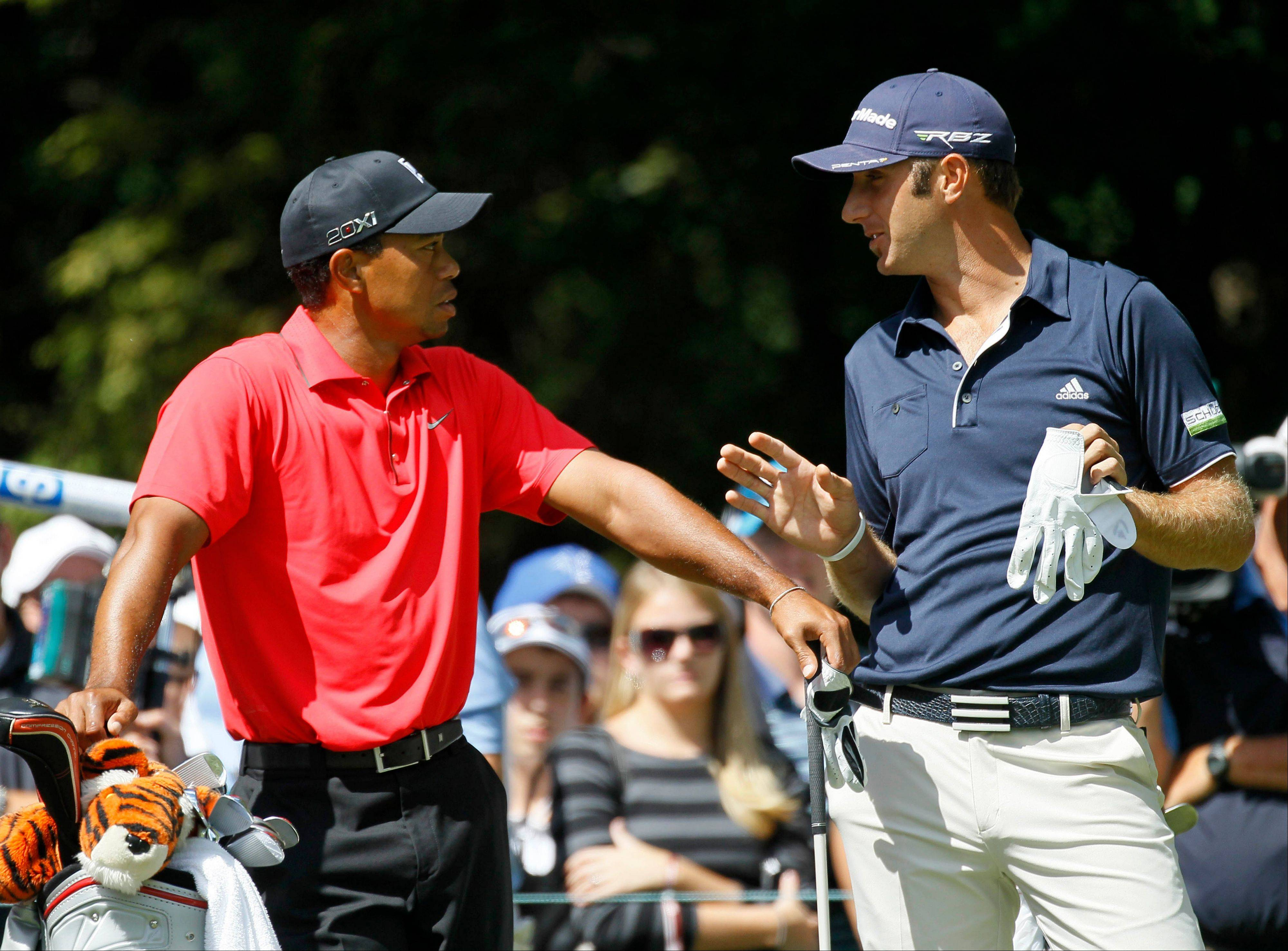 Tiger Wood, left, and Dustin Johnson will be teammates at the 39th Ryder Cup. They played together in the final round of the BMW Championship at Crooked Stick Golf Club in Carmel, Ind. on Sunday.