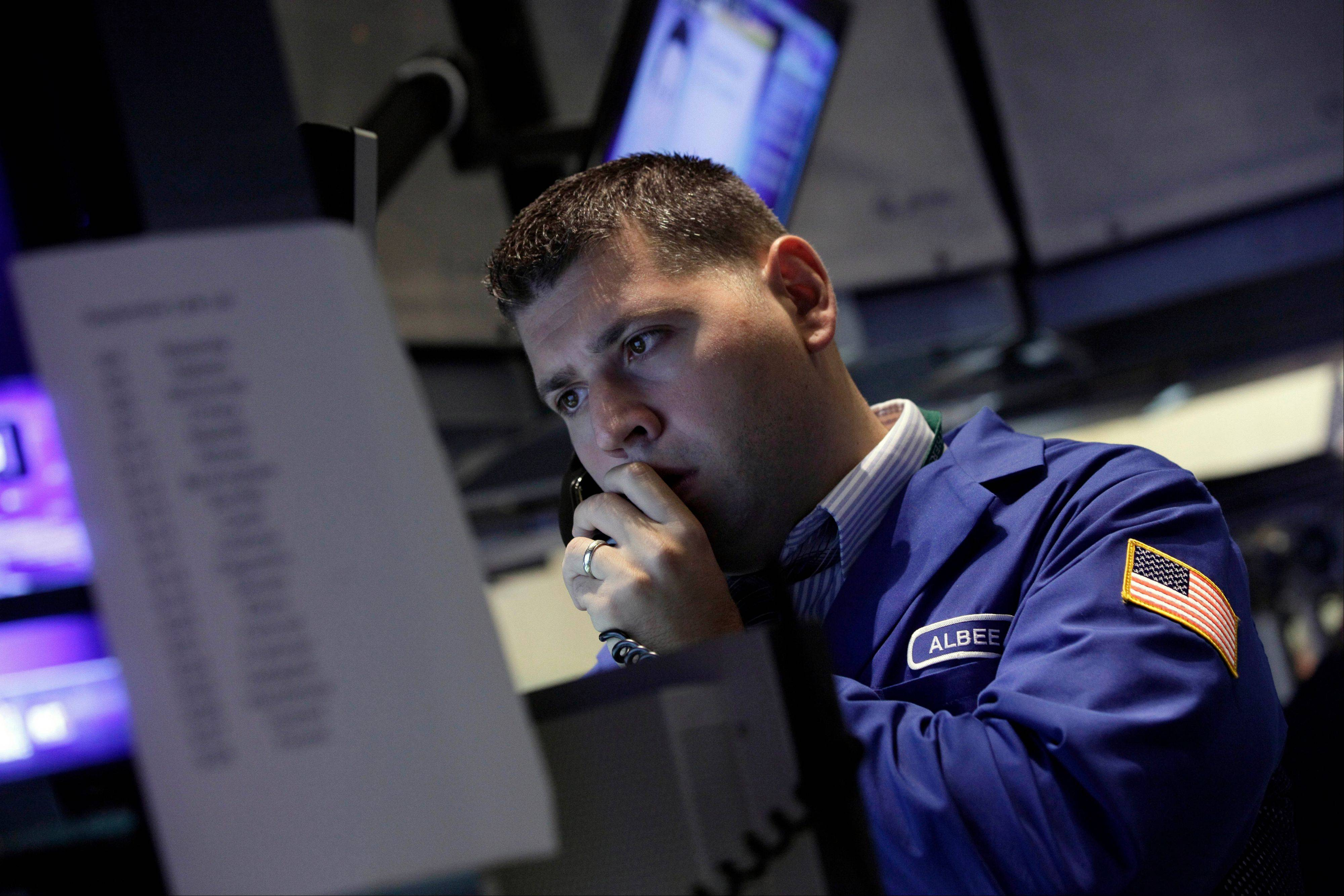 A specialist works Friday on the floor of the New York Stock Exchange.