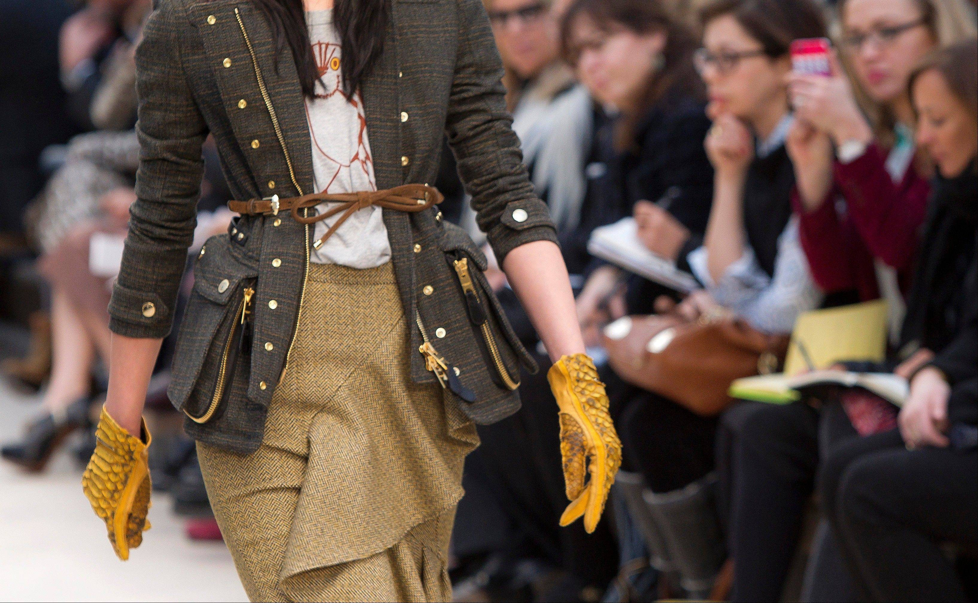 Burberry Group Plc, the U.K.'s largest luxury-goods maker, said full-year profit will disappoint after sales growth slowed globally, sending the shares down the most ever and rattling those of peers.