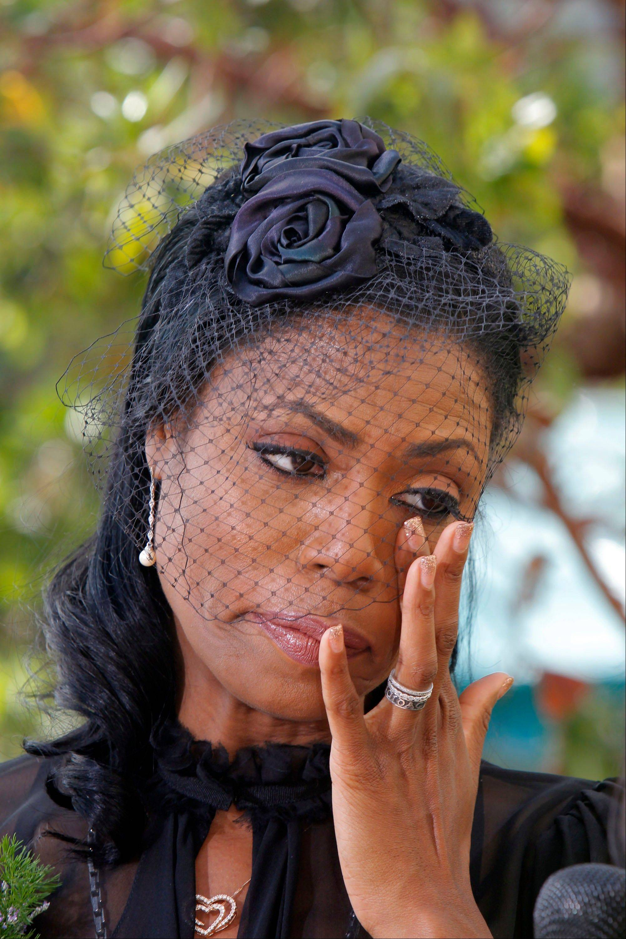Michael Clarke Duncan's fiancee Omarosa Manigault wipes away tears during the memorial service in Los Angeles on Monday.