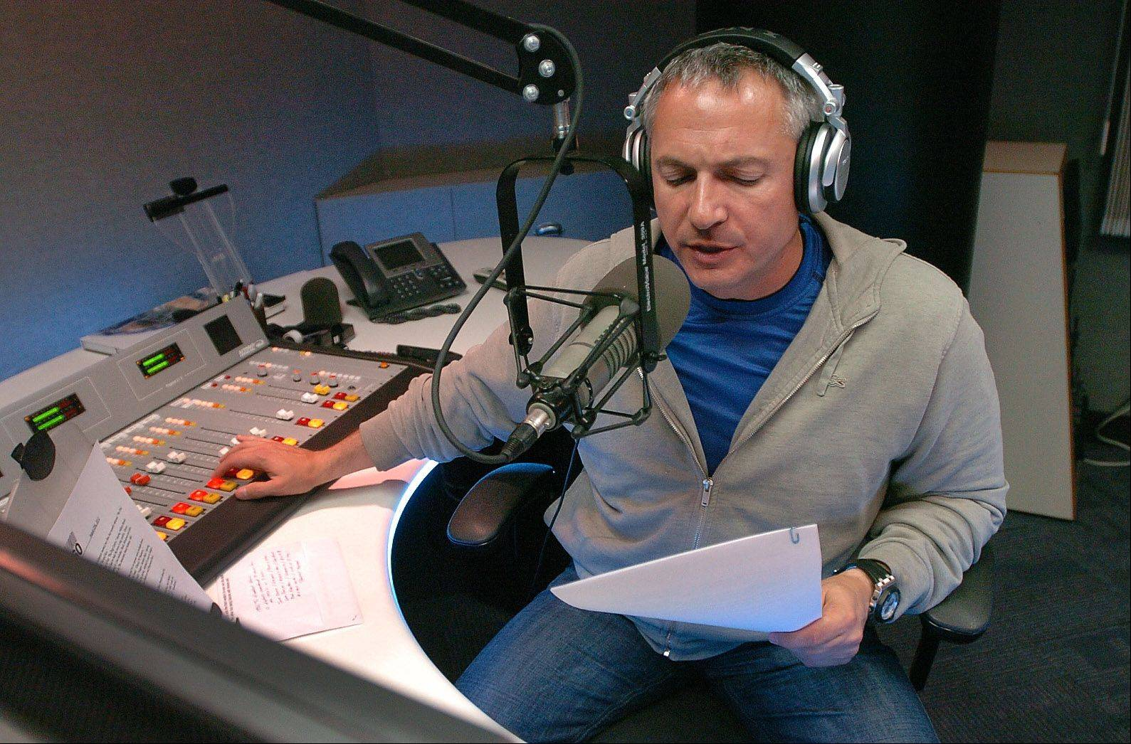 "Carl Amari of South Barrington hosts the nationally syndicated classic radio and showbiz show, ""Hollywood 360,"" during a Saturday night last month in the WIND AM-560 studios in Elk Grove Village. He's now branching out from classic radio to produce feature films in Hollywood."