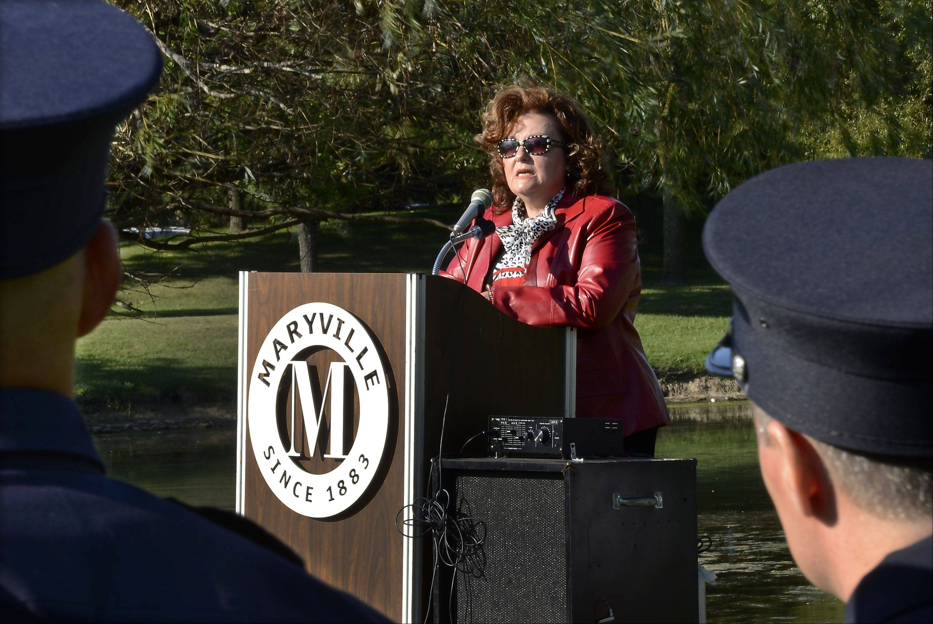 Firefighters listen as former Palatine Mayor Rita Mullins remembers landing in Washington D.C. moments after the Pentagon had been hit by a passenger jet killing all on board and 125 military personnel on Sept. 11, 2000. She spoke during a 9/11 Patriot Day celebration at Maryville Academy in Des Plaines.