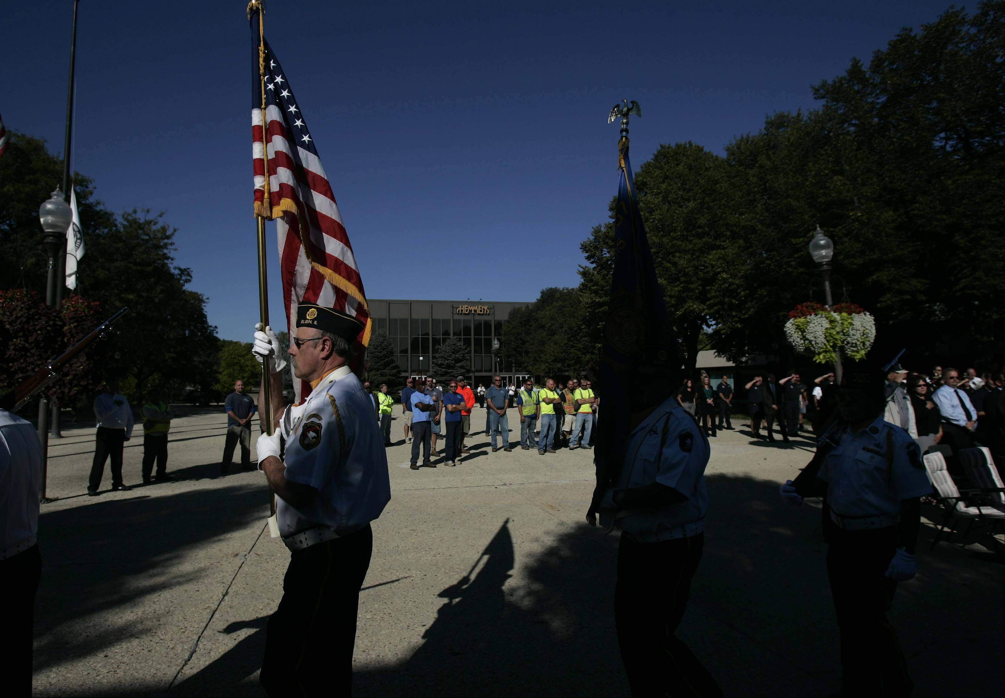 Rich Hamilton of American Legion Post 57 retires the colors after the 9/11 ceremony Tuesday at the Elgin City Plaza.