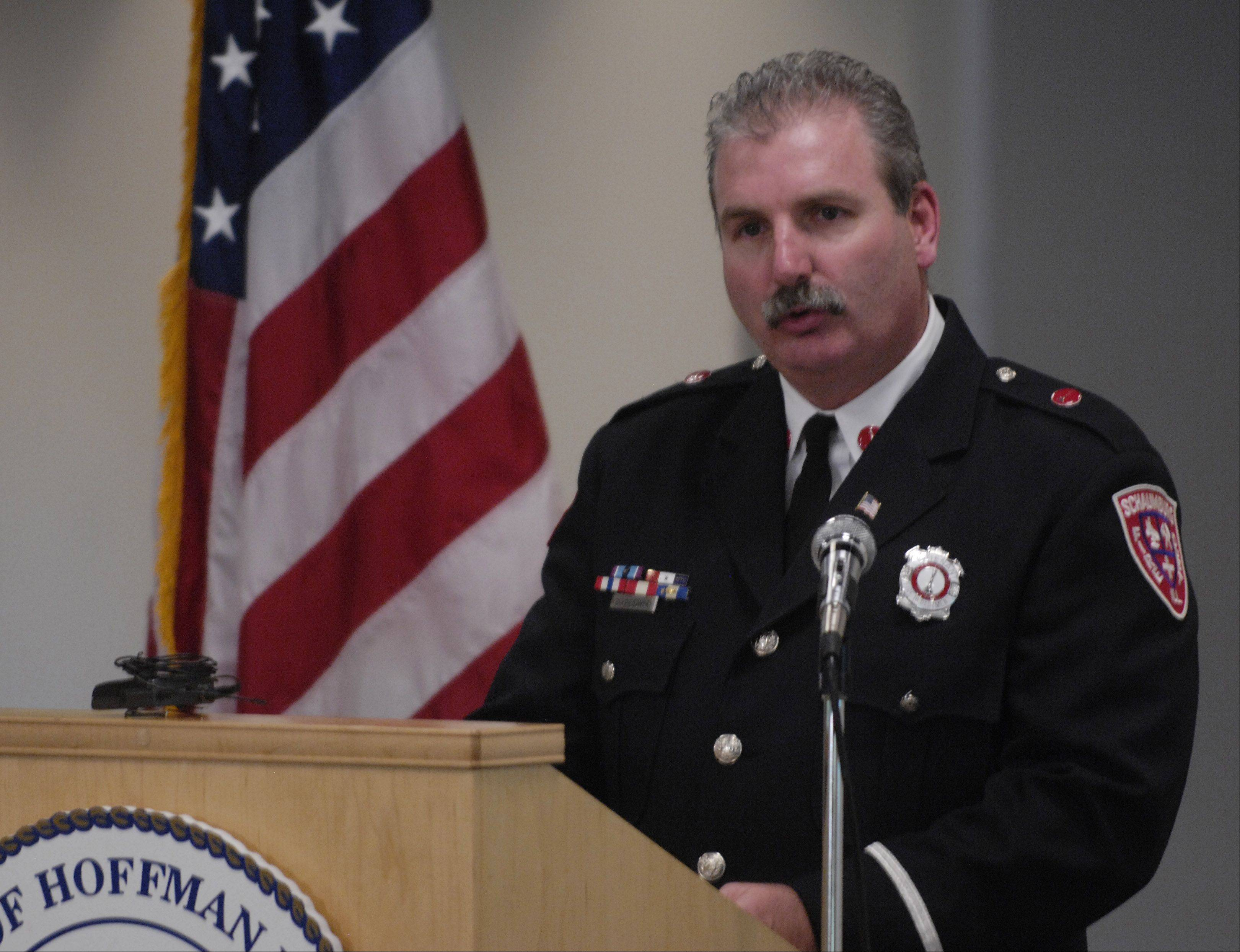 Schaumburg Fire Department Lieutenant John Schneidwind, who assisted at Ground Zero in the wake of 9/11, speaks during the Hoffman Estates annual September 11th Ceremony of Remembrance at the Village Hall Tuesday.
