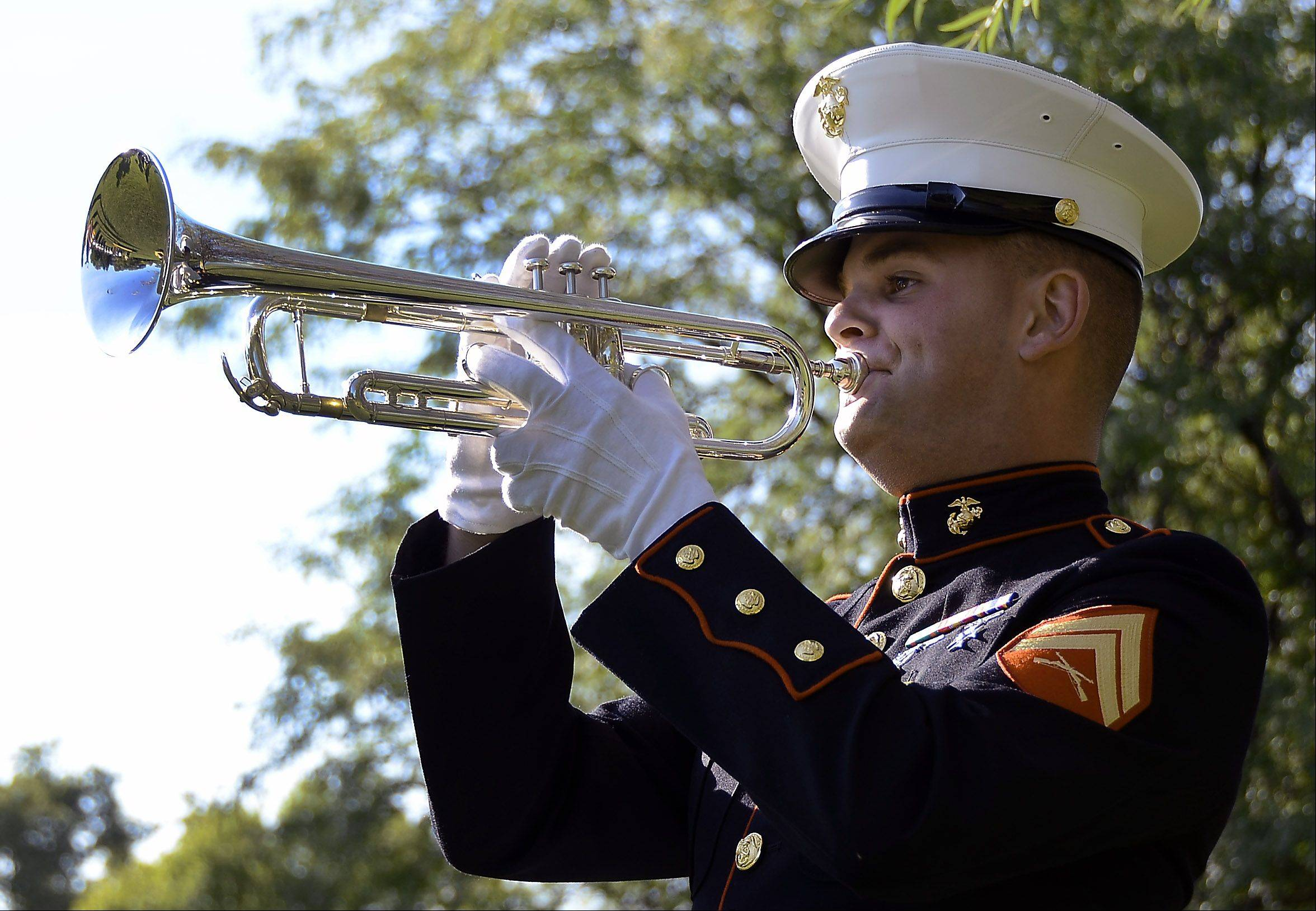 Corporal Marshal Macri, USMC, Marine Band San Diego plays Taps at the close of a 9/11 Patriot Day celebration at Maryville Academy in Des Plaines.