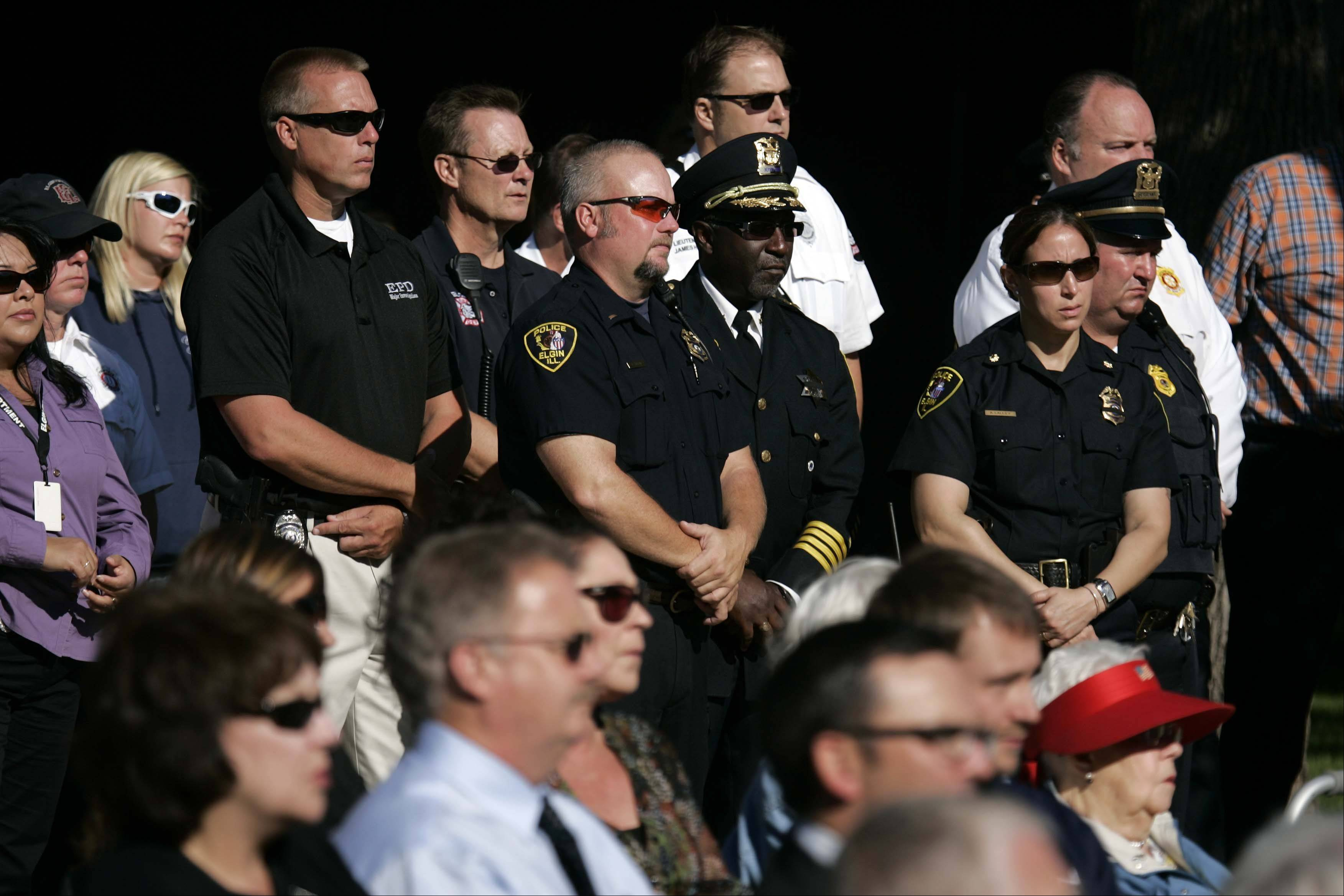 Elgin Police and fire personnel during the 9/11 ceremony Tuesday at the Elgin City Plaza.