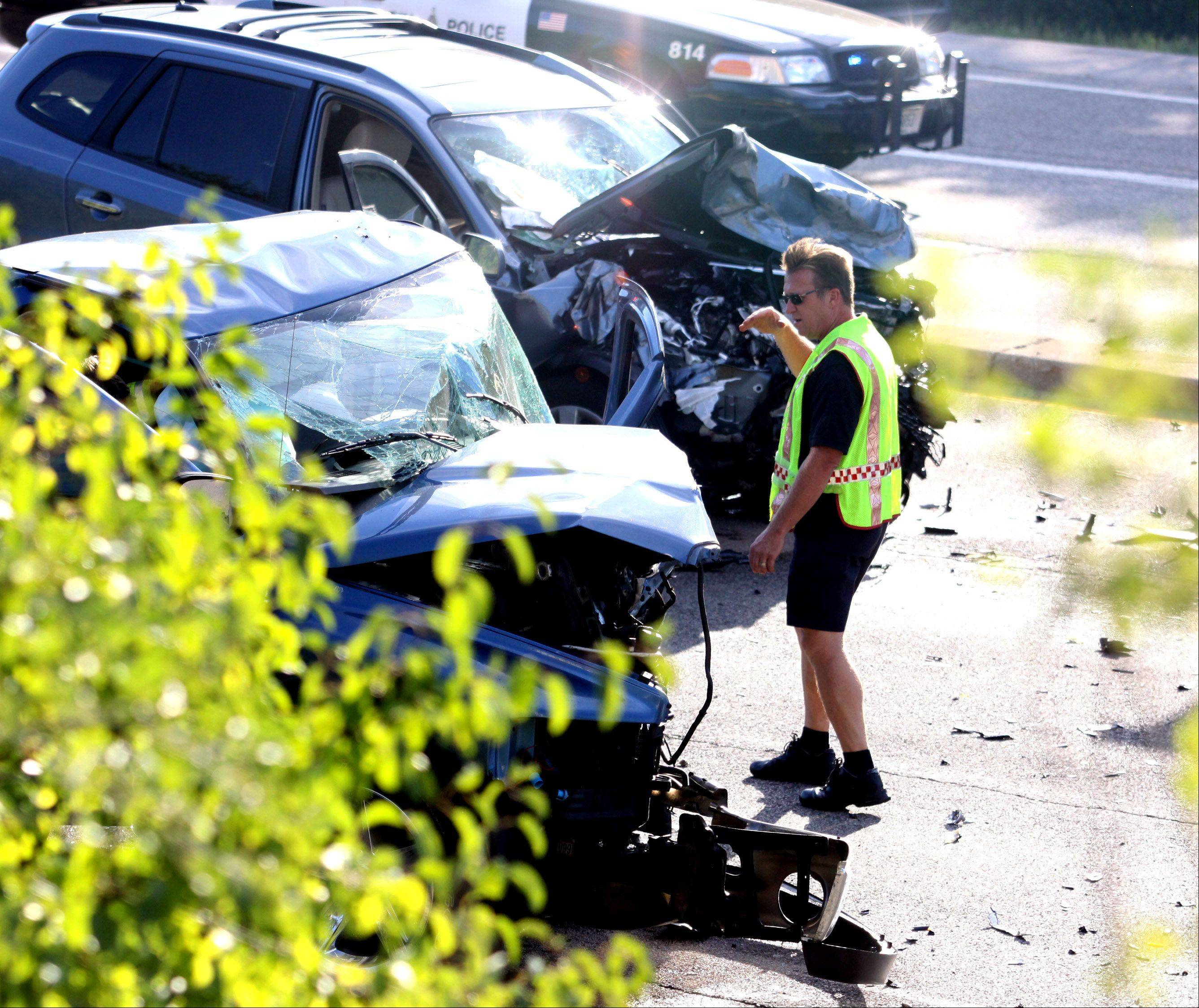 Elgin police and fire personnel examine the scene of a crash in the northbound lanes of Route 31 near the interchange with the Jane Addams Memorial Tollway on Tuesday afternoon.